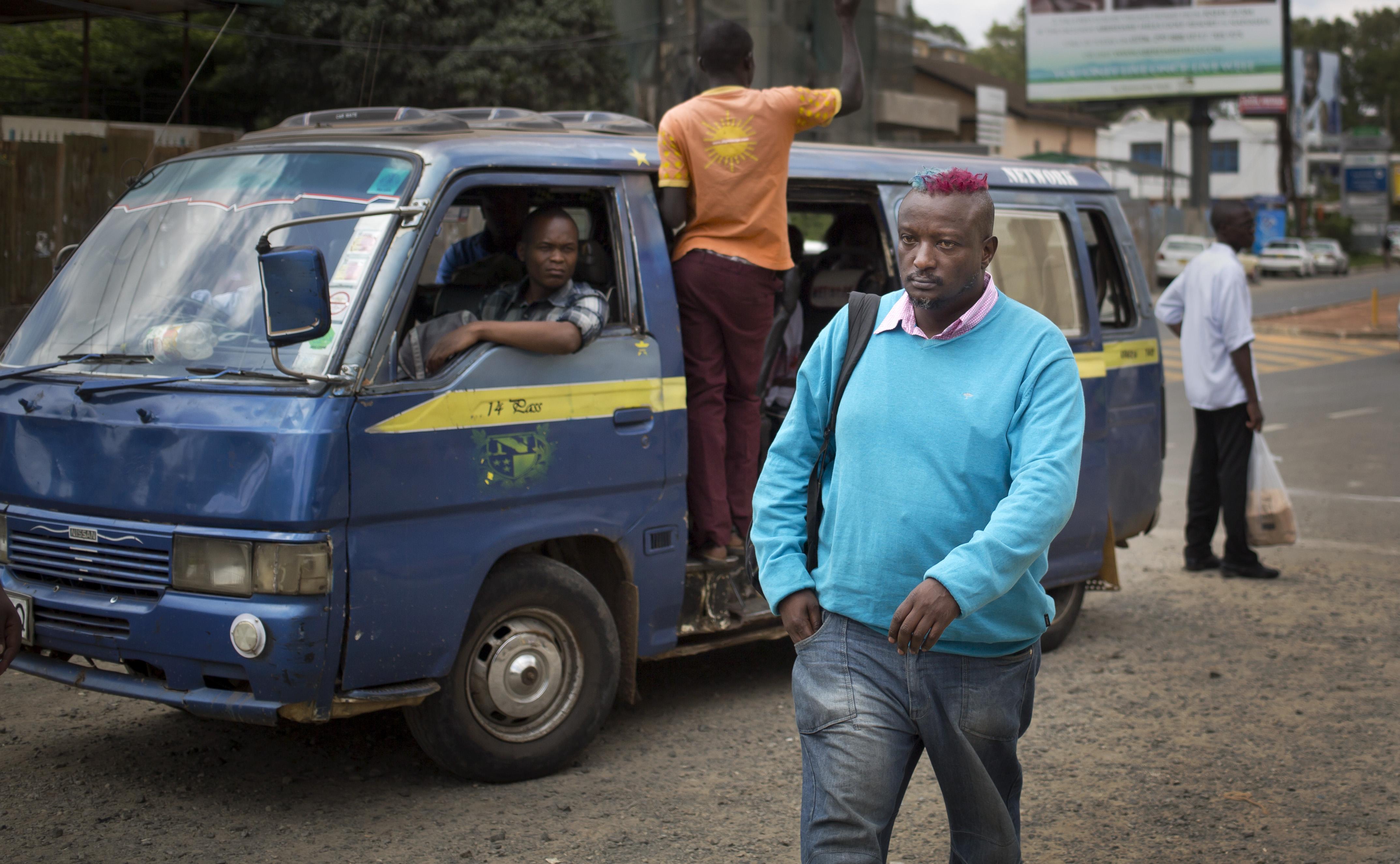 Prize-winning Kenyan author Binyavanga Wainaina walks down a street in Nairobi, Kenya Wednesday.