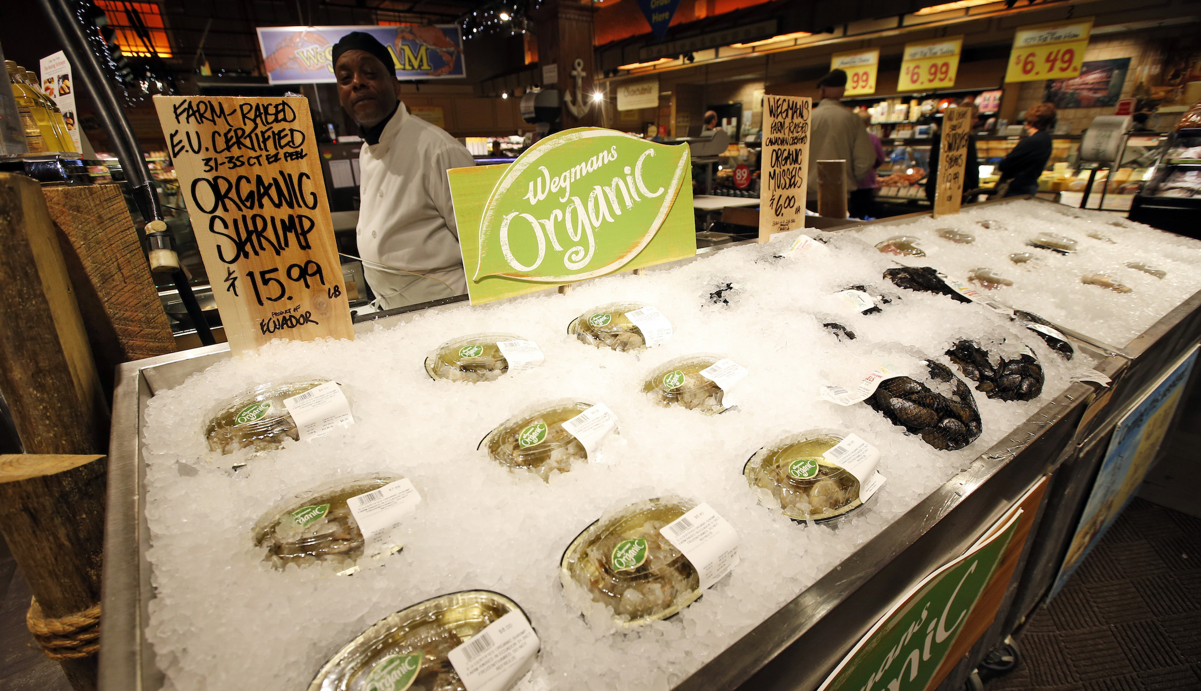 EU certified organic farm-raised shrimp and Canadian certified organic mussels are for sale on at the Wegmans, Friday, April 10, 2015 in Fairfax, Va. Organic fish is certified in the EU and Canada because the US doesn't have any standard. (AP Photo/Alex Brandon)