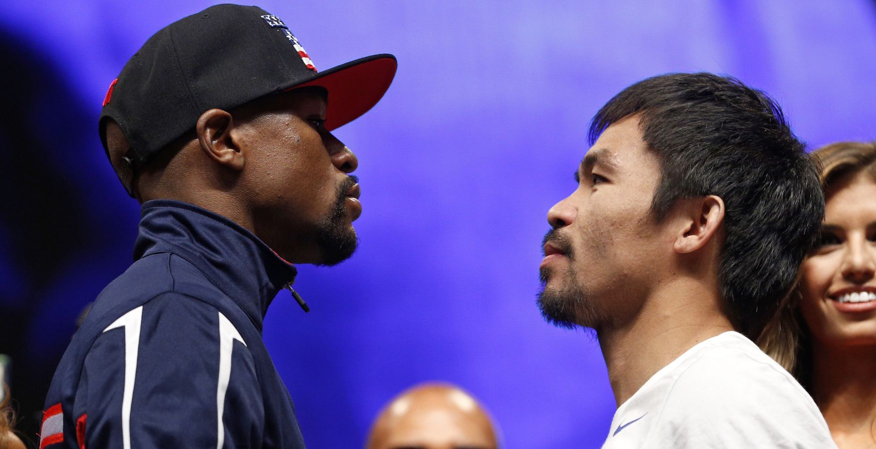 Floyd Mayweather Jr., left, and Manny Pacquiao pose during their weigh-in on Friday, May 1, 2015 in Las Vegas. The world weltherweight title fight between Mayweather Jr. and Pacquiao is scheduled for May 2. (AP Photo/John Locher)