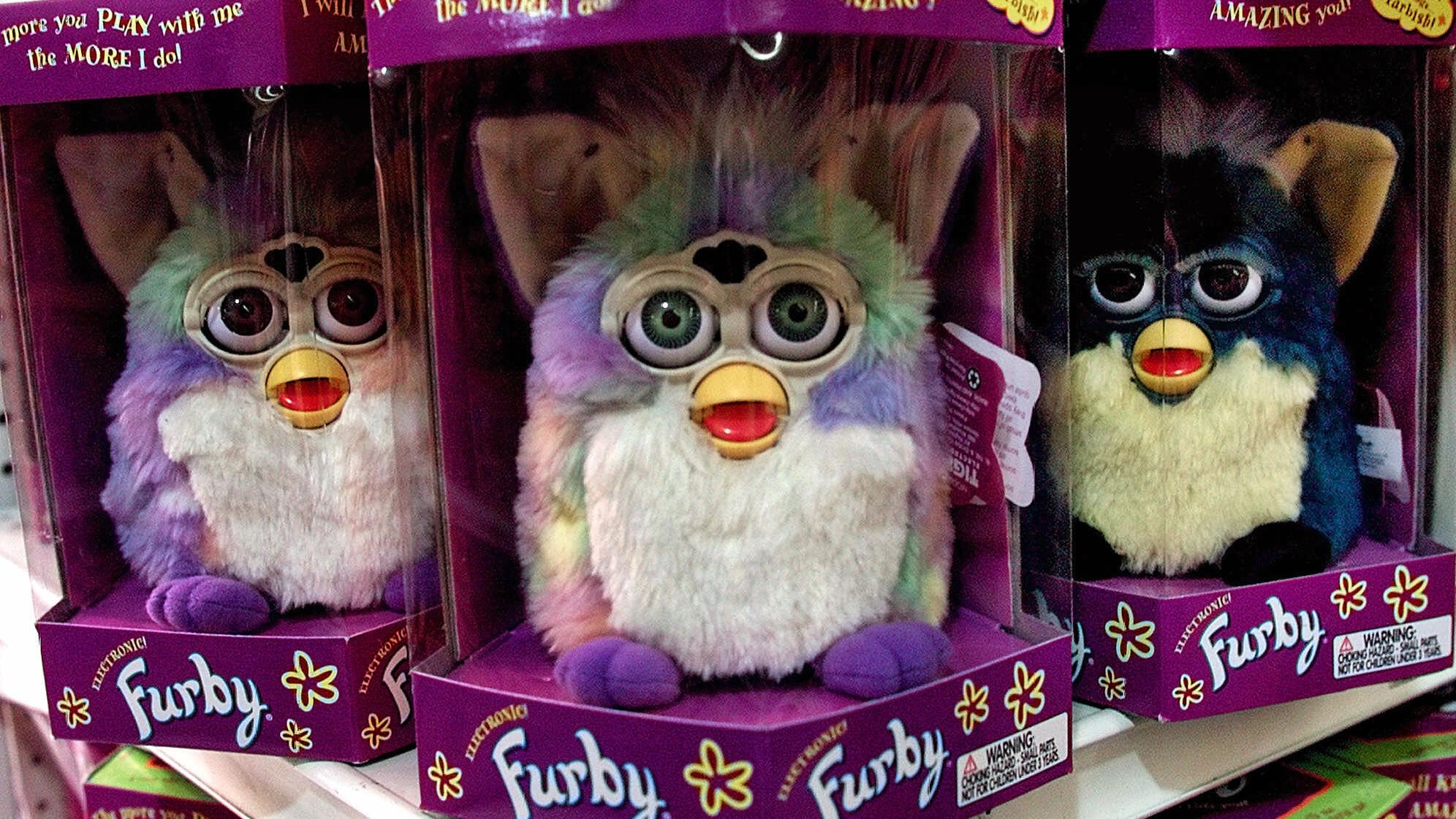 A display of Furby dolls, an interactive children's toy, is seen on display at a Toys 'R' Us store in Glendale, Calif., Wednesday, Sept. 29, 1999. The Sept. 21 earthquake that devastated parts of Taiwan is sending tremors through the toy and personal computer industries, which rely on Taiwanese semiconductors for products ranging from personal computers to interactive Furby dolls. (AP Photo/Damian Dovarganes)