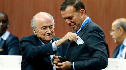 Juan Angel Napout of Paraguay receives his nomination at the Executive Committee from FIFA President Sepp Blatter (R) at the 65th FIFA Congress in Zurich, Switzerland, May 29, 2015.