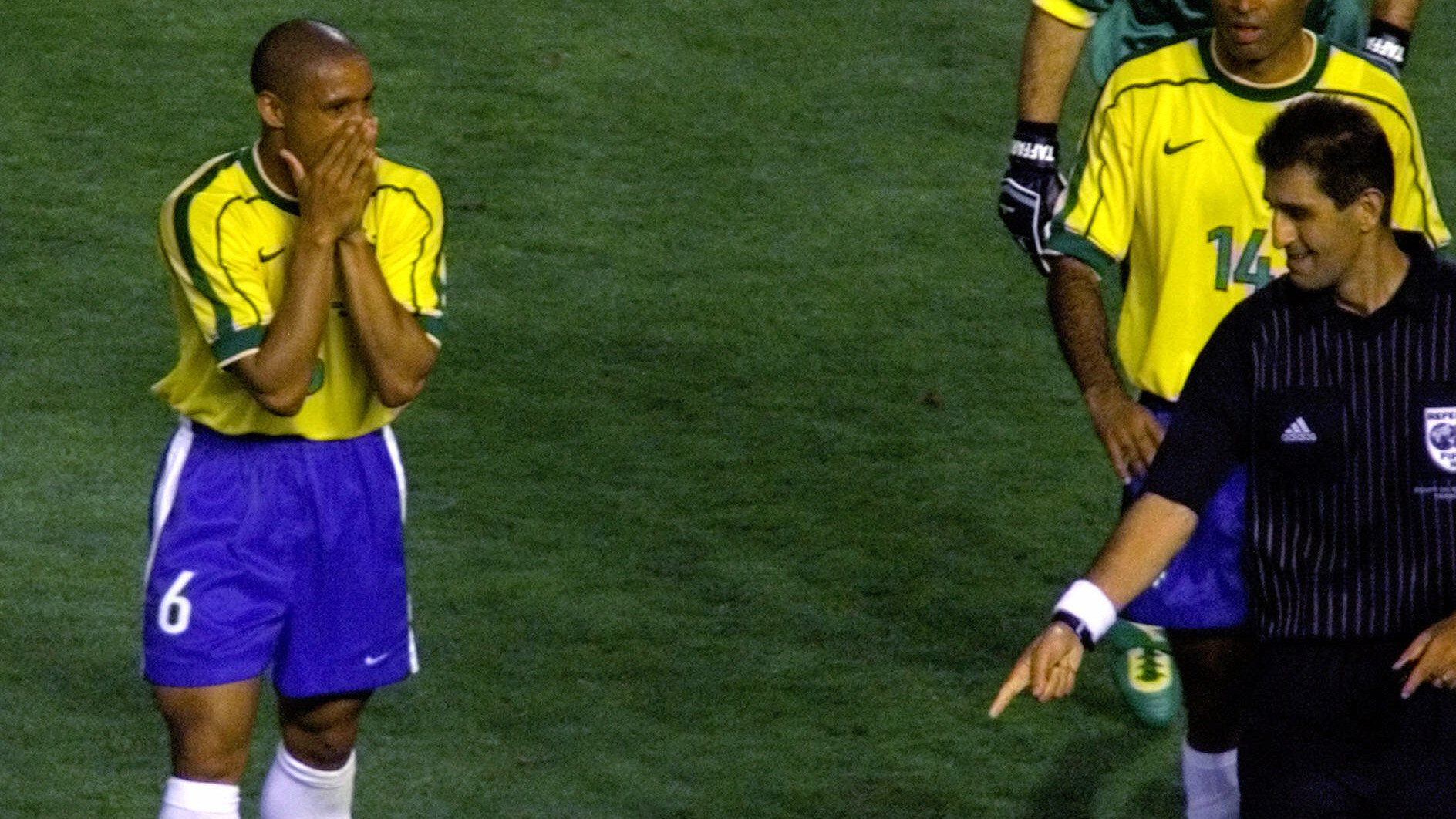 Esfandiar Baharmast, referee from the USA, points at the foul spot that led to a penalty shot for Norway as Brazil's Roberto Carlos covers his face during the Brazil vs. Norway, Group A, World Cup 98, soccer match at the Velodrome stadium in Marseille, Tuesday, June 23, 1998. The other teams in Group A are Scotland and Morocco. Norway won 2-1.