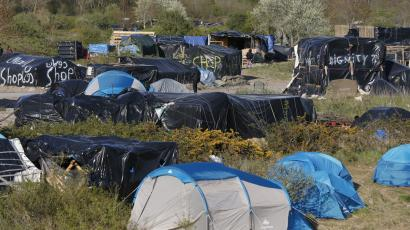 General view of a field with tents and makeshift shelters where migrants and asylum seekers stay in Calais, France, April 30, 2015.