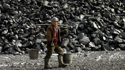 DATE IMPORTED:February 22, 2005A Chinese miner walks past a coal heap outside a mine near Datong February 22, 2005. Worries that high prices for raw materials and energy will rekindle Chinese inflation are fading after the latest batch of data showed price pressures easing at both the consumer and producer level. REUTERS/Reinhard Krause