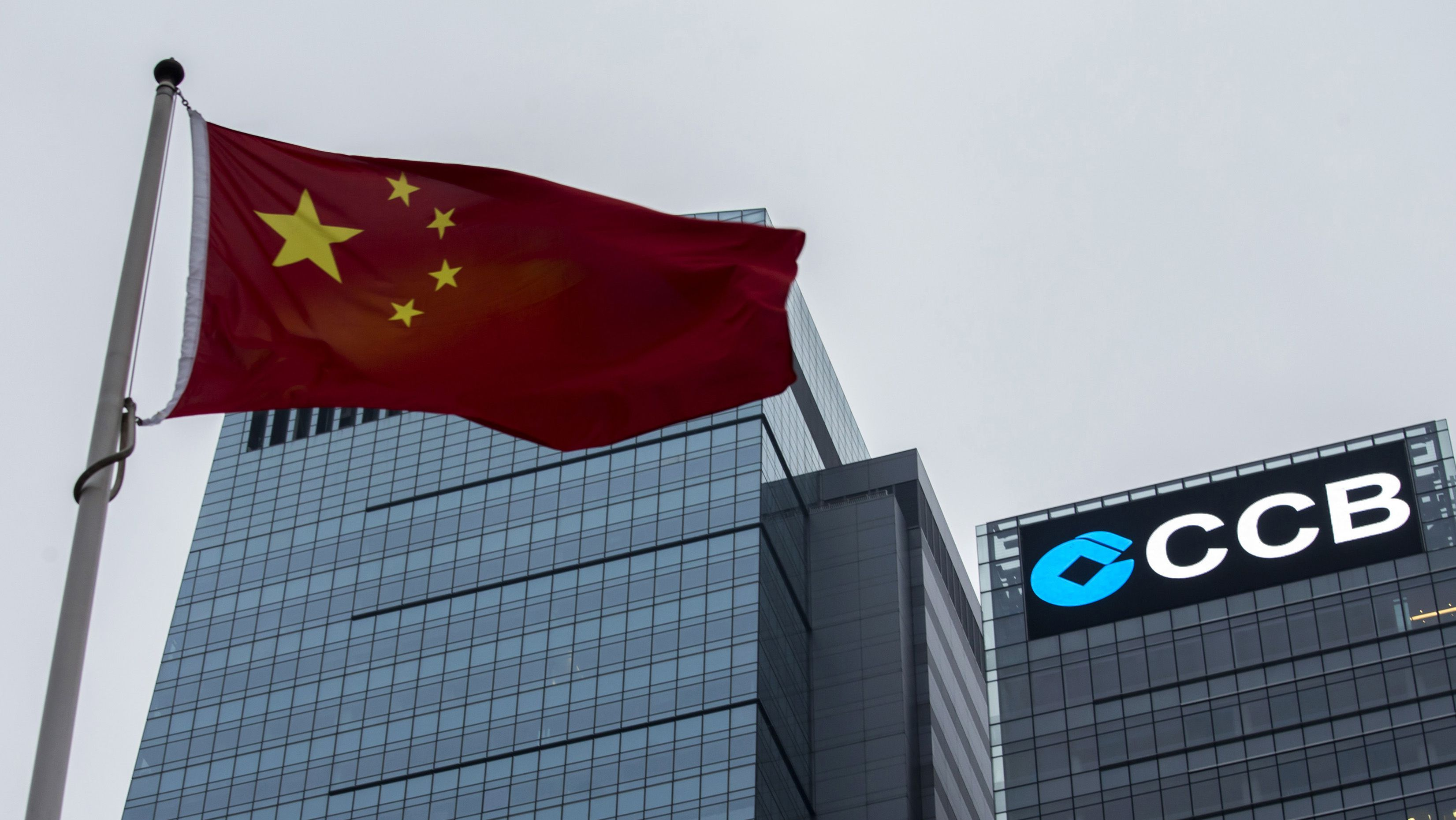 DATE IMPORTED:December 29, 2014A Chinese national flag flies in front of the China Construction Bank (CCB) Tower at Hong Kong's business Central district December 26, 2014. REUTERS/Tyrone Siu