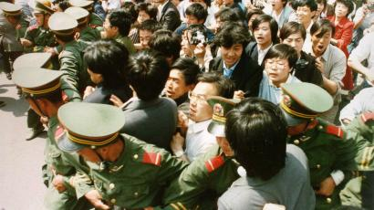 Crowds of jubilant students surge through a police cordon before pouring into Tiananmen Square on June 4, 1989 during a pro-democracy demonstration.
