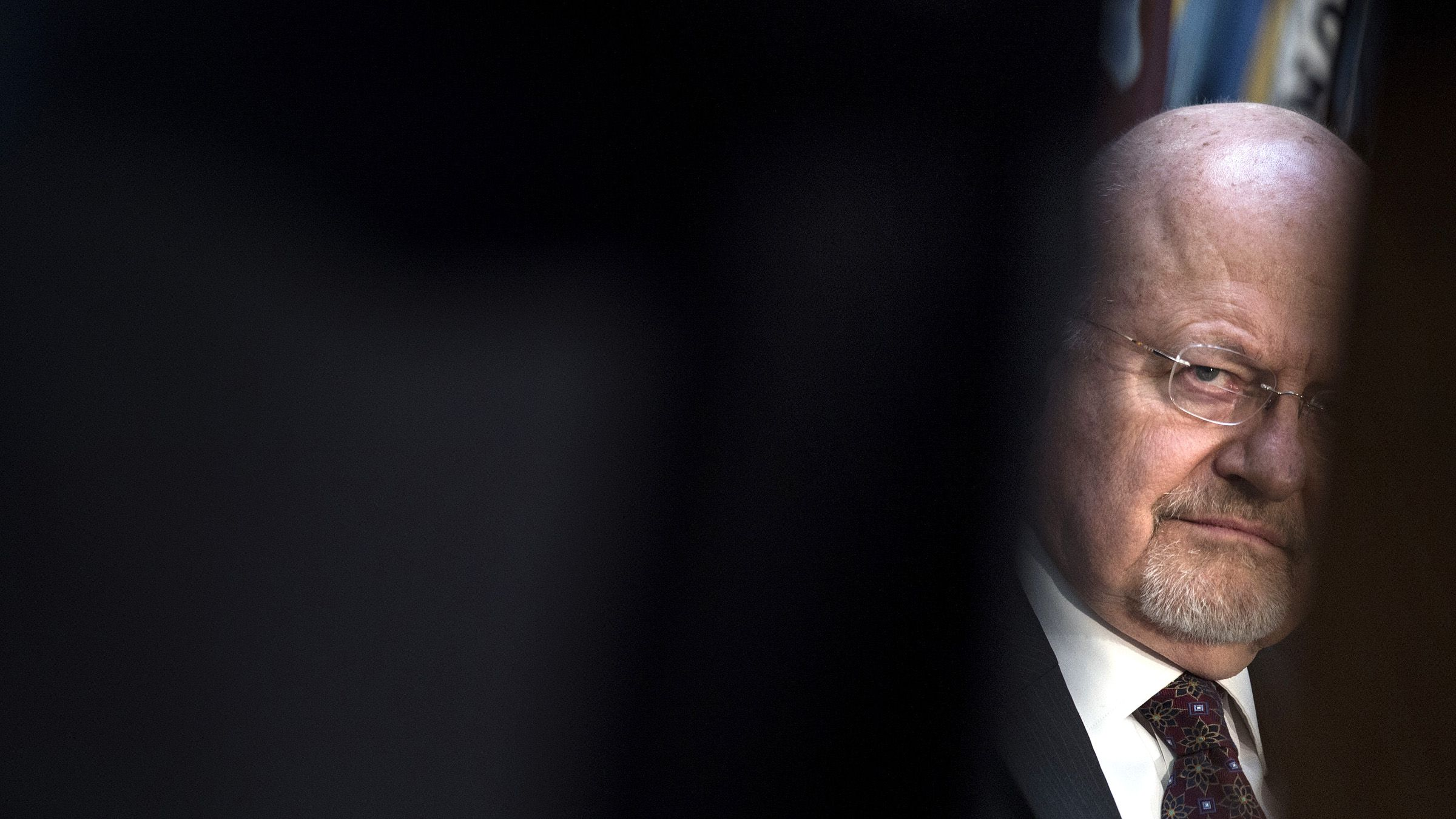 Director of National Intelligence James R. Clapper listens during a retirement ceremony at the National Security Agency in Fort Meade, Maryland March 28, 2014.