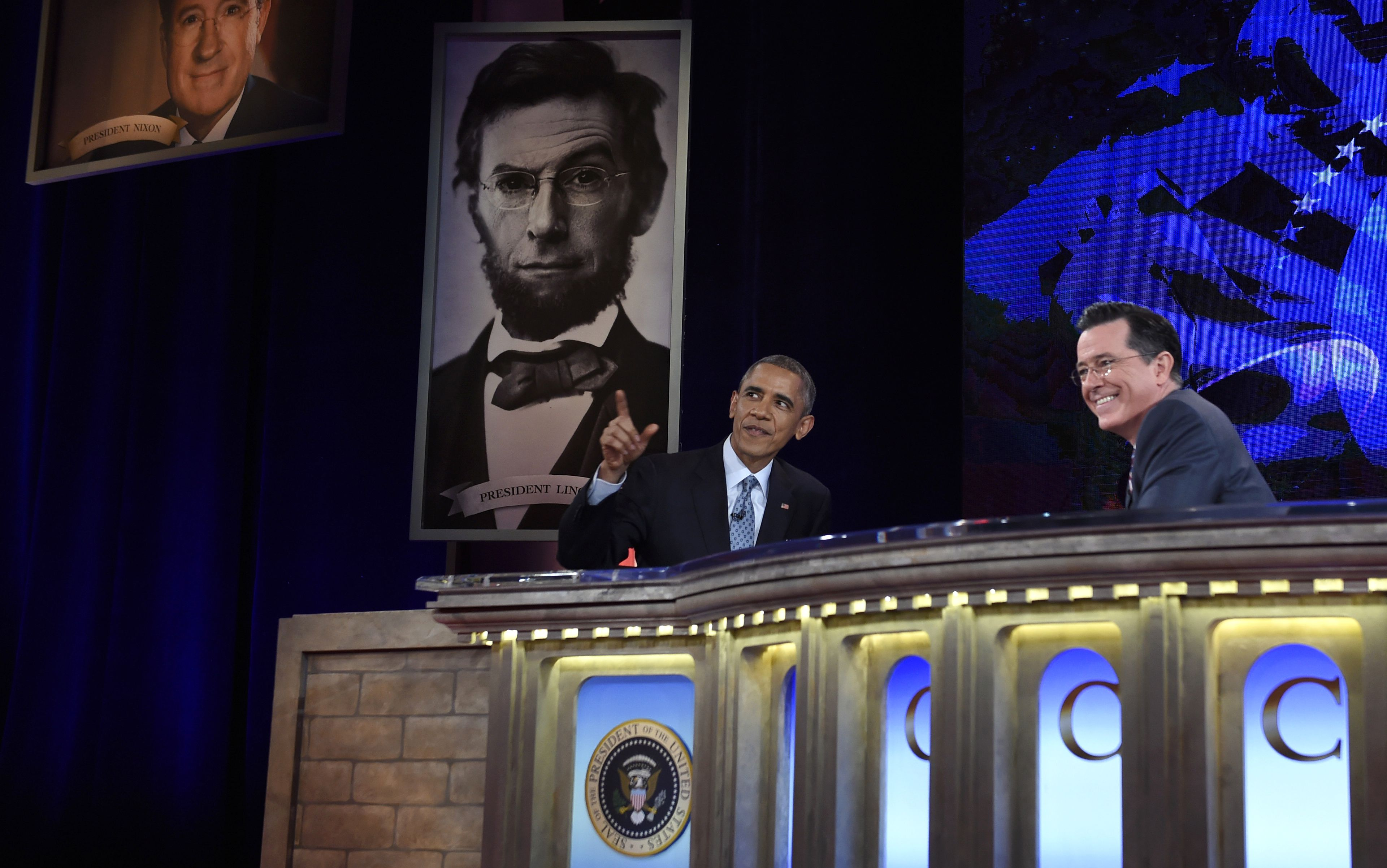 President Barack Obama talks with Stephen Colbert of The Colbert Report during a taping of The Colbert Report program in Lisner Auditorium at George Washington University in Washington, Monday, Dec. 8, 2014. (AP Photo/Susan Walsh)