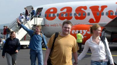 Passengers disembark from low-cost airline easyJet's plane.