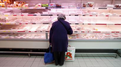 A woman shops at a supermarket in Nice, southern France.