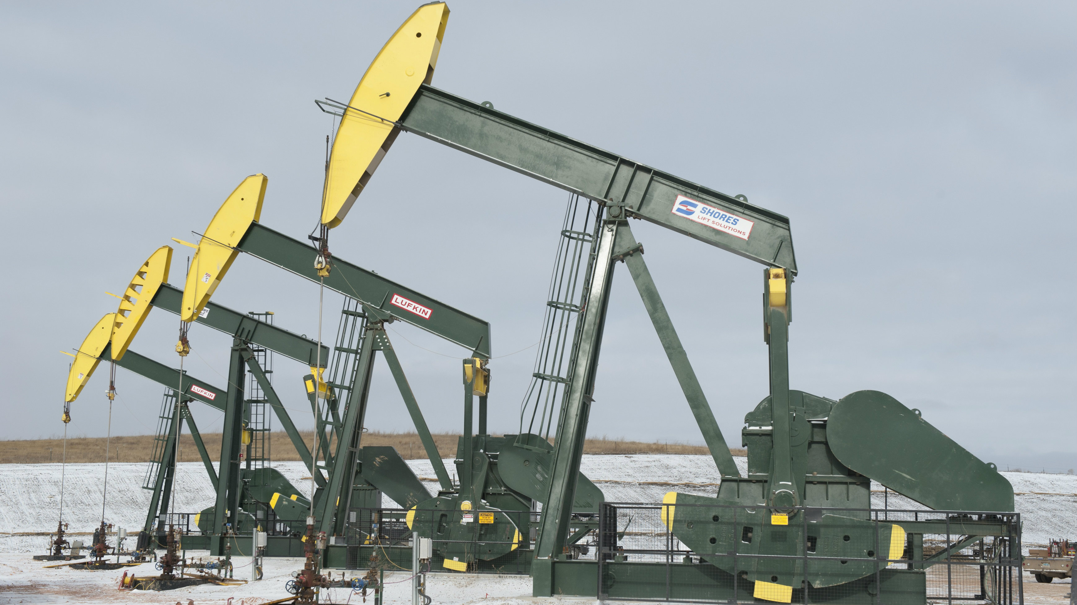 Pumpjacks taken out of production temporarily stand idle at a Hess site while new wells are fracked near Williston, North Dakota November 12, 2014.