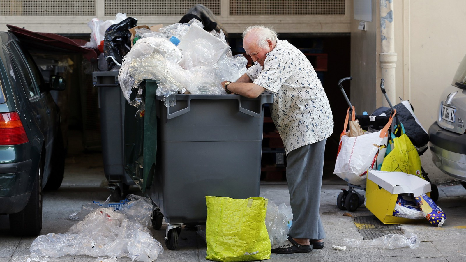 Eugene, an 87-year-old retired Frenchman, searches for food in a garbage container next to a supermarket in Nice June 13, 2013. A former interior decorator, and a pensioner of 24 years, Eugene lives in Nice and is the owner of a small apartment in a bourgeois district of the city. Although he receives a monthly pension of 1000 euros (1300 $US), he started rummaging through trash bins to collect food in 2012, as he did when a teenager during World War II, because 'times are hard' he said. He drives his old car seeking out supermarket trash containers in different parts of the city to fill his fridge. Eugene dreams of going to Las Vegas. Following a government report today June 14, 2013 the French should pay contributions for longer to get a full pension and well-off pensioners should get fewer tax rebates.