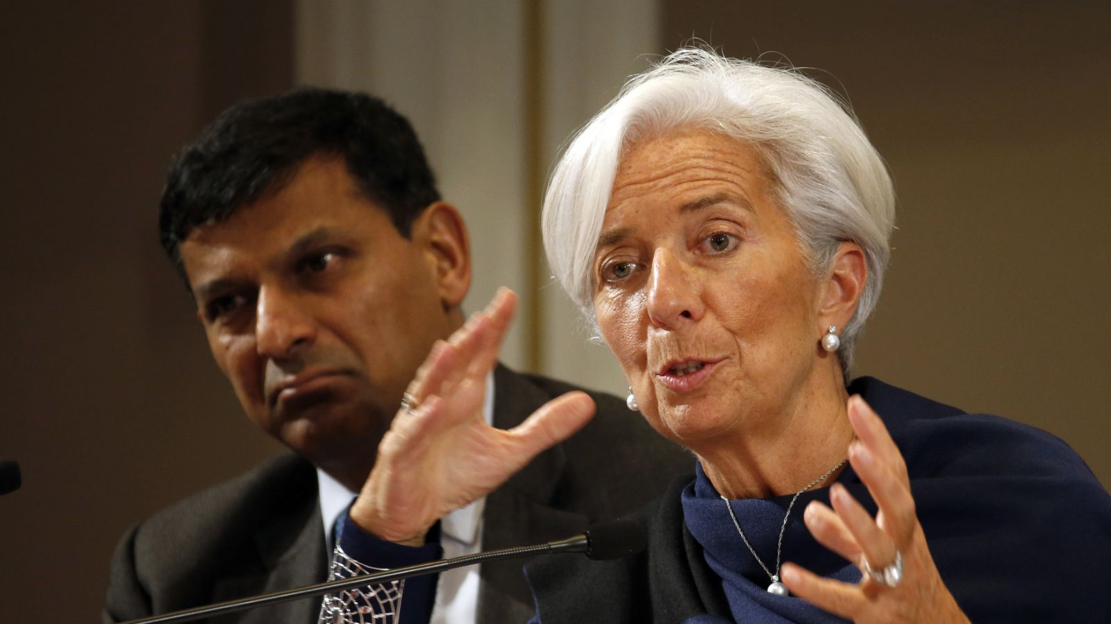 IMF President Christine Lagarde attends a conference of central bankers hosted by the Bank of France in Paris November 7, 2014. Listening at Left is Reserve Bank of India (RBI) Governor Raghuram Rajan.