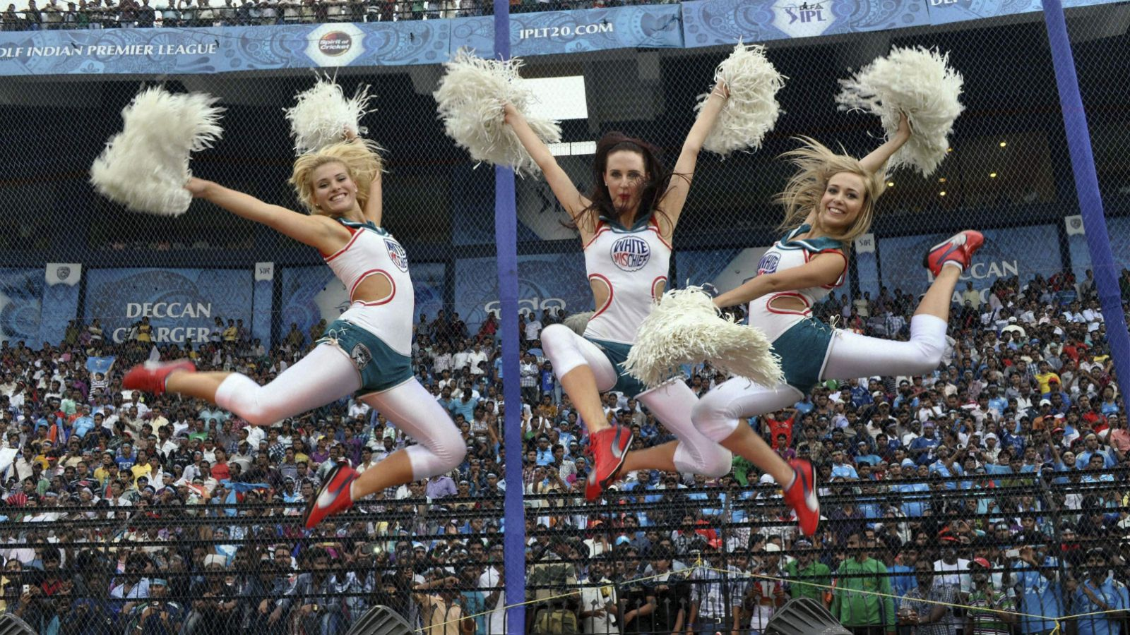 Cheerleaders perform during an Indian Premier League (IPL) match between Pune Warriors and Deccan Chargers in Cuttack, India, Tuesday, May 1, 2012.