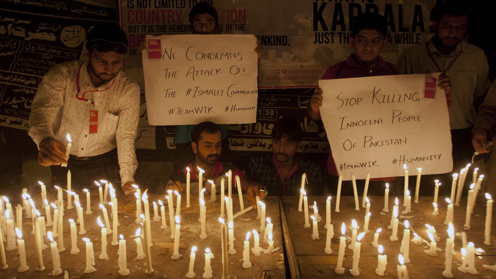 People light candles to protest and show solidarity with the victims of a bus attack in Karachi, Pakistan, Wednesday, May 13, 2015. Gunmen stormed a bus in southern Pakistan and ordered its Shiite Muslim passengers to bow their heads before shooting them, killing dozens of people in the latest attack targeting religious minority, officials said.