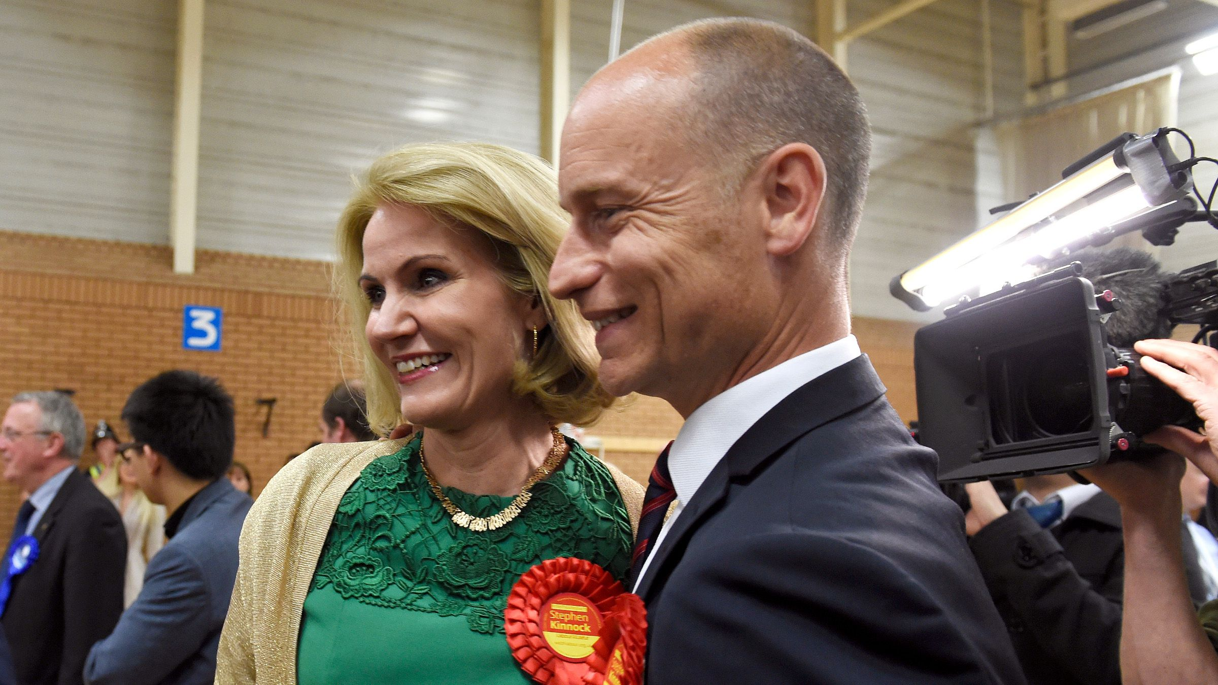 Danish Prime Minister Helle Thorning-Schmidt celebrates with her husband Stephen Kinnock as he is elected the Member of Parliament for the Aberavon Constituency in the Neath Sports Centre, Neath, South Wales, May 8, 2015.