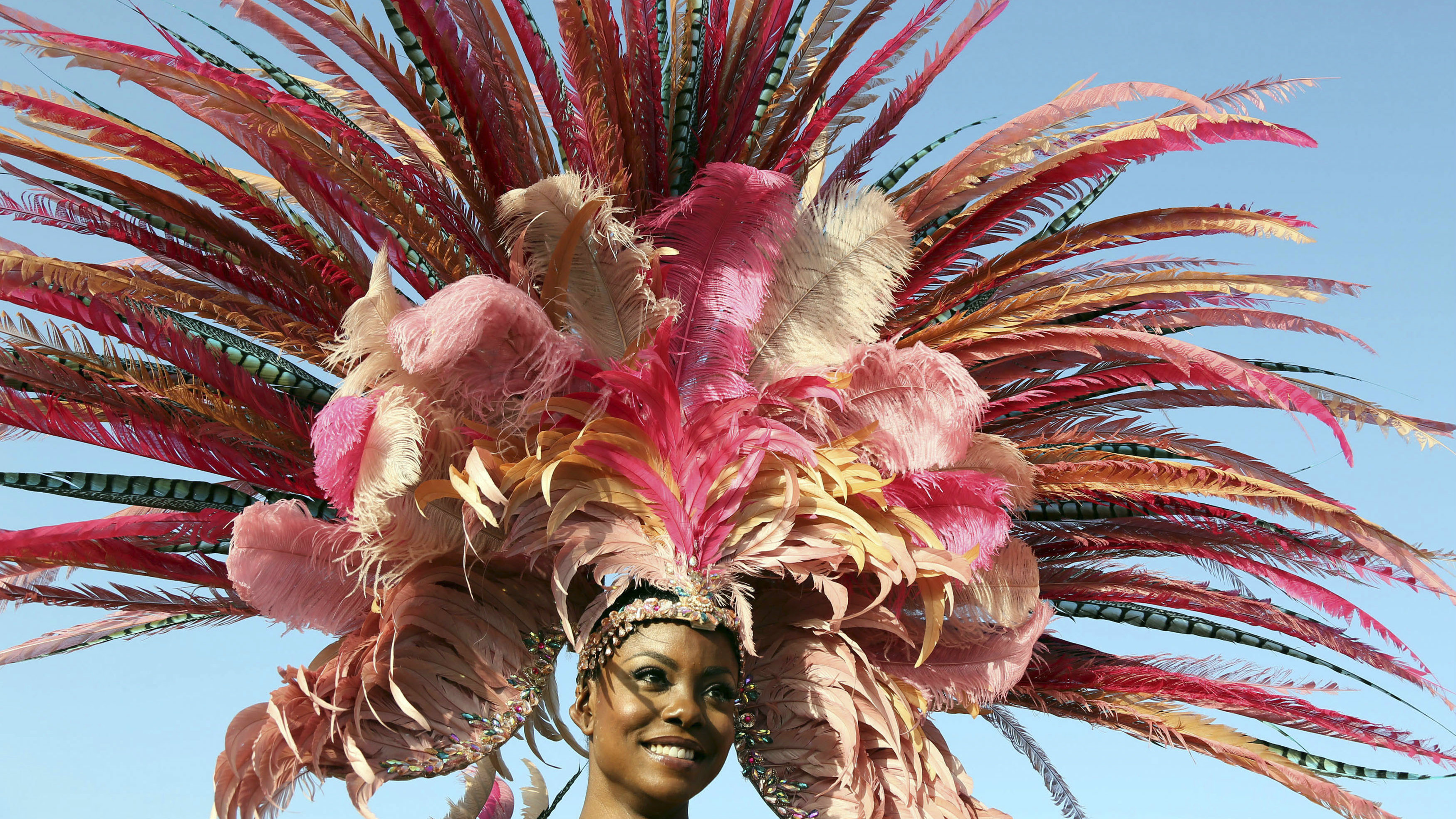 """Trinidad's former Miss Universe Wendy Fitzwilliam performs in an individual mas costume during Hart's Carnival 2014 presentation """"Of Love and War,"""" as the band crosses the stage at the Queen's Park Savannah on the final day of the parade of bands in the annual Carnival festival, in Port-of-Spain, March 4, 2014. REUTERS/Andrea De Silva"""