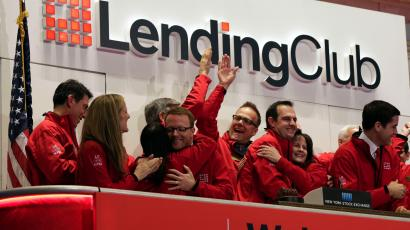 Renaud Laplanche, third from right, Founder & CEO of Lending Club, embraces company CFO Carrie Dolan during opening bell ceremonies of the New York Stock Exchange, to mark Lending Club's IPO, Thursday, Dec. 11, 2014.