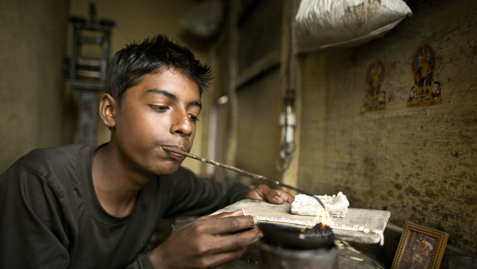 Sameer Singh, 12, works at a jewelry workshop where he earns US$ 32 a month, in Gauhati, India, Wednesday, Dec. 10, 2014. Nobel Peace Prize winners Malala Yousafzai from Pakistan and Kailash Satyarthi of India on Tuesday stressed the importance of uniting people across borders and religions by educating children and freeing them from poverty. The Nobel laureates, who split the $1.1 million award, were cited for working to protect children from slavery, extremism and child labor at great risk to their own lives. (AP Photo/Anupam Nath)