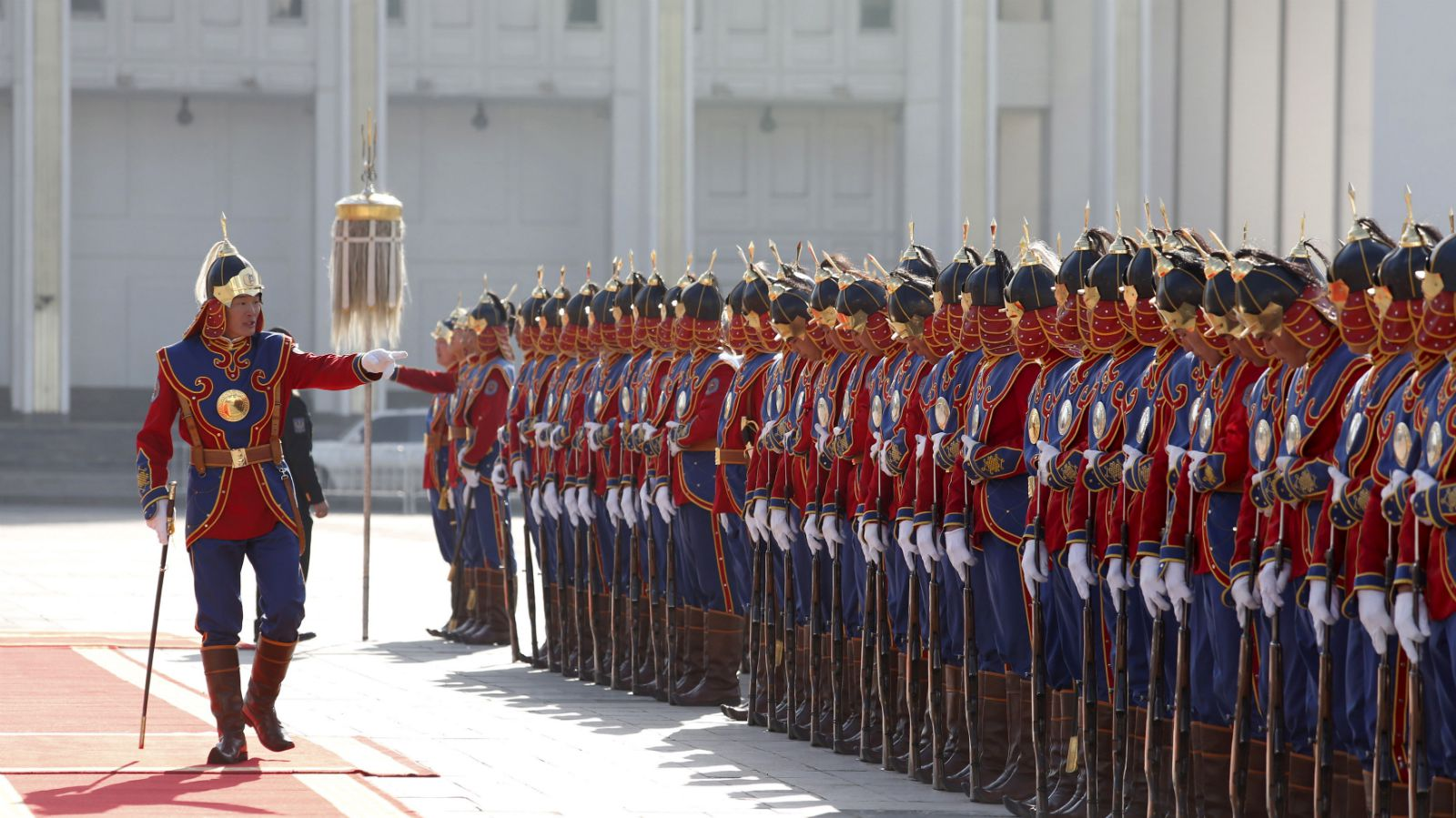 Commander (L) of an honour guards gestures as he prepares his troops before a welcoming ceremony for the visiting Bulgarian President Rosen Plevneliev (not pictured) outside the national parliament building at Sukhbaatar square, in Ulan Bator, Mongolia, May 11, 2015.