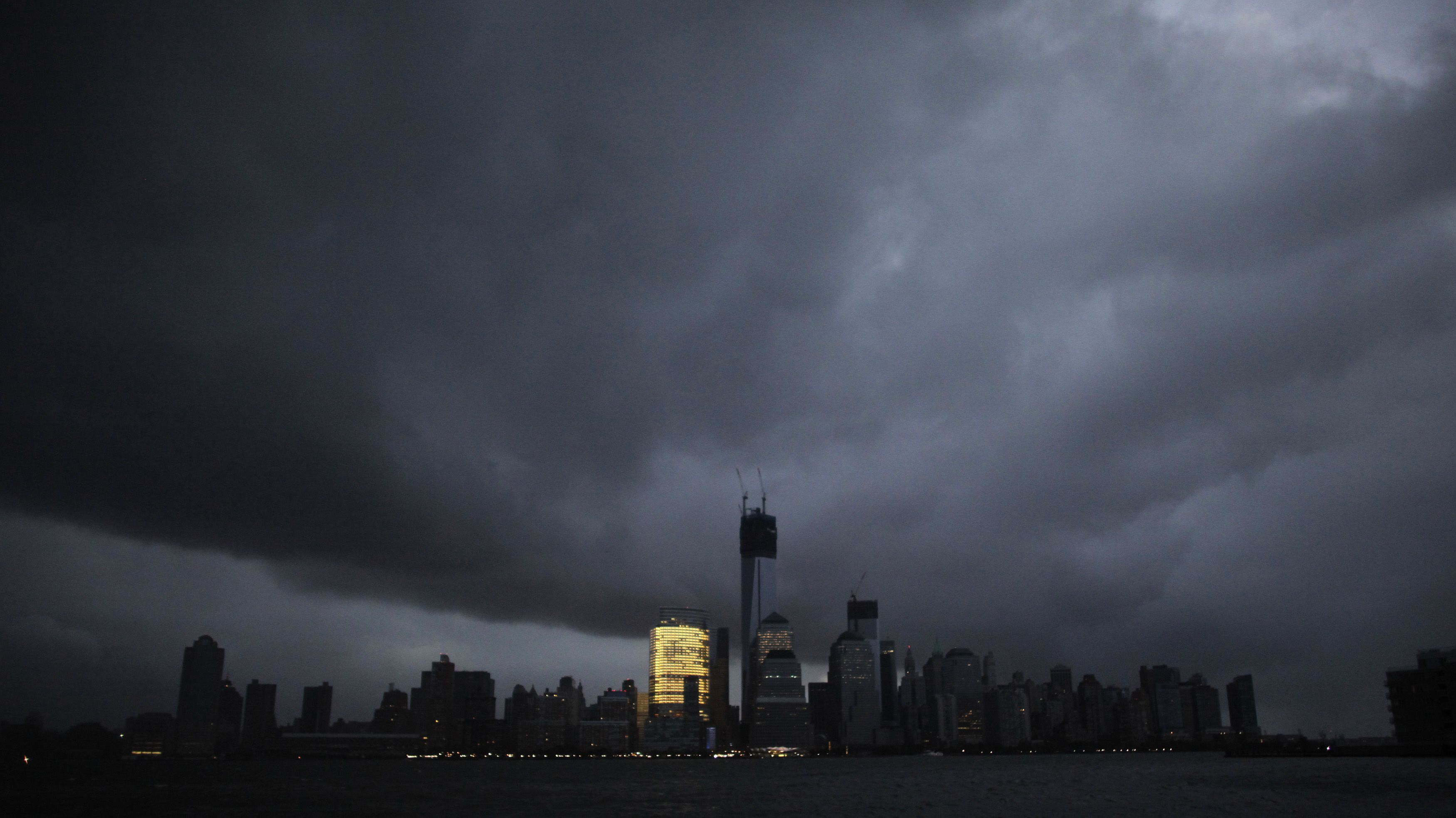 The skyline of lower Manhattan,  as seen from Exchange Place, is mostly in darkness except for the Goldman Sachs building after a preventive power outage caused by giant storm Sandy, in New York October 30, 2012. Millions of people in the eastern United States awoke on Tuesday to flooded homes, fallen trees and widespread power outages caused by Sandy, which swamped New York City's subway system and submerged streets in Manhattan's financial district. More than two-thirds of the U.S. East Coast's refining capacity was shut down and fuel pipelines idled due to Hurricane Sandy. Early assessments show the region's biggest plants may have escaped without major damage. REUTERS/Eduardo Munoz (UNITED STATES - Tags: ENVIRONMENT DISASTER ENERGY CITYSPACE TPX IMAGES OF THE DAY) FOR BEST QUALITY IMAGE ALSO SEE: GM1E8BU19QD01.  FOR EDITORIAL USE ONLY. NO COMMERCIAL SALES WORLDWIDE UNTIL JANUARY 7, 2018. FOR MORE INFORMATION, PLEASE CONTACT YOUR CONTACT YOUR LOCAL SALES REPRESENTATIVEî. - RTR39RLY