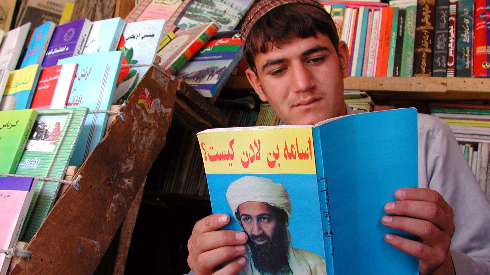 An Afghan book-seller reads a book on Saudi-born dissident, Osama bin Laden in the capital on September 17, 2001. The United States have named bin Laden as the prime suspect in the co-ordinated attacks against America last week and has threatened to launch an assault on Afghanistan to punish him. Afghans are nervous and worried about the attack as bin Laden denies links with the deadly incidents.