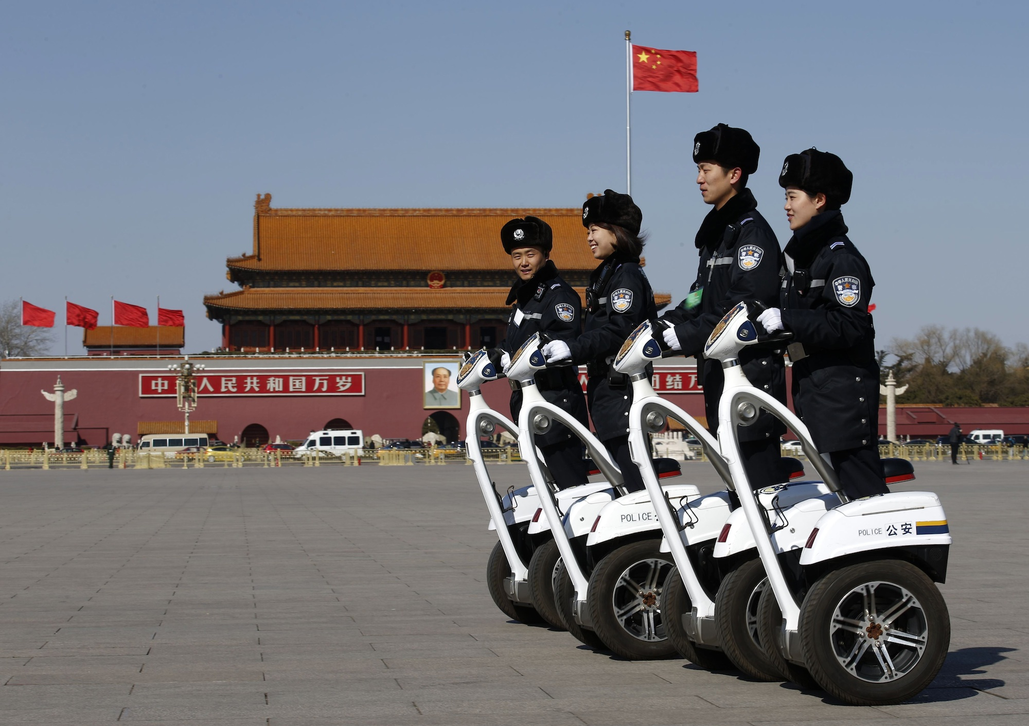 Police offices ride on motorized vehicles ahead of the opening session of Chinese People's Political Consultative Conference (CPPCC) at Tiananmen Square in Beijing, March 3, 2015. REUTERS/Kim Kyung-Hoon