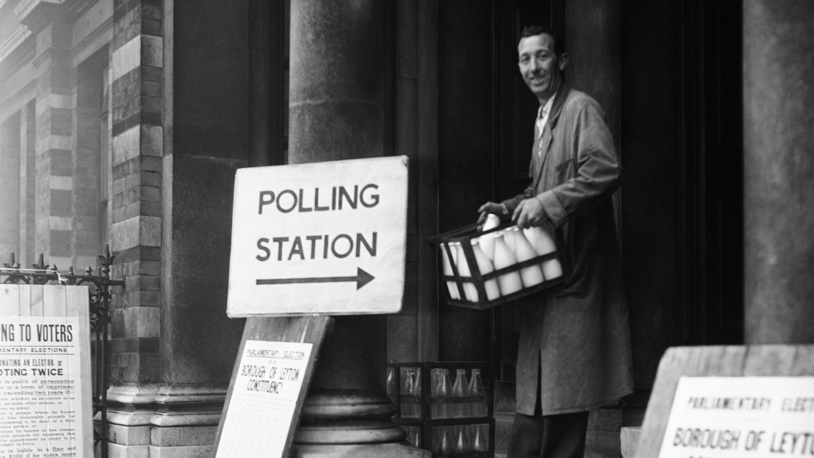 It was just striking seven o'clock when milkman Bill Hughes delivered the milk at Leyton Town Hall in London on Oct. 8, 1959. He left he milk on the Town Hall steps and went in to the polling station to cast his ballot along with the early voters. (AP Photo)