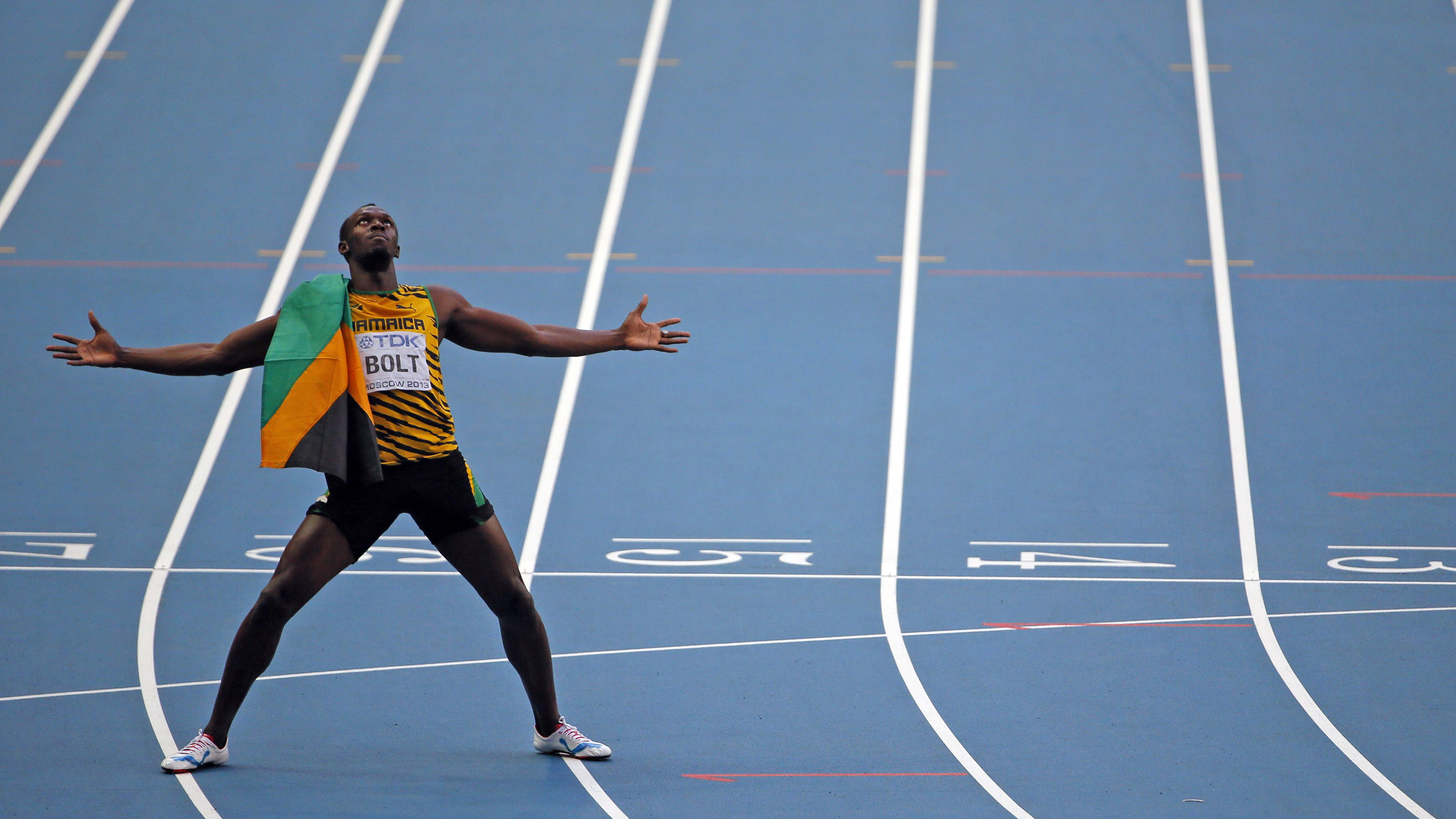 Winner Usain Bolt of Jamaica celebrates after the men's 200 metres final during the IAAF World Athletics Championships at the Luzhniki stadium in Moscow August 17, 2013.