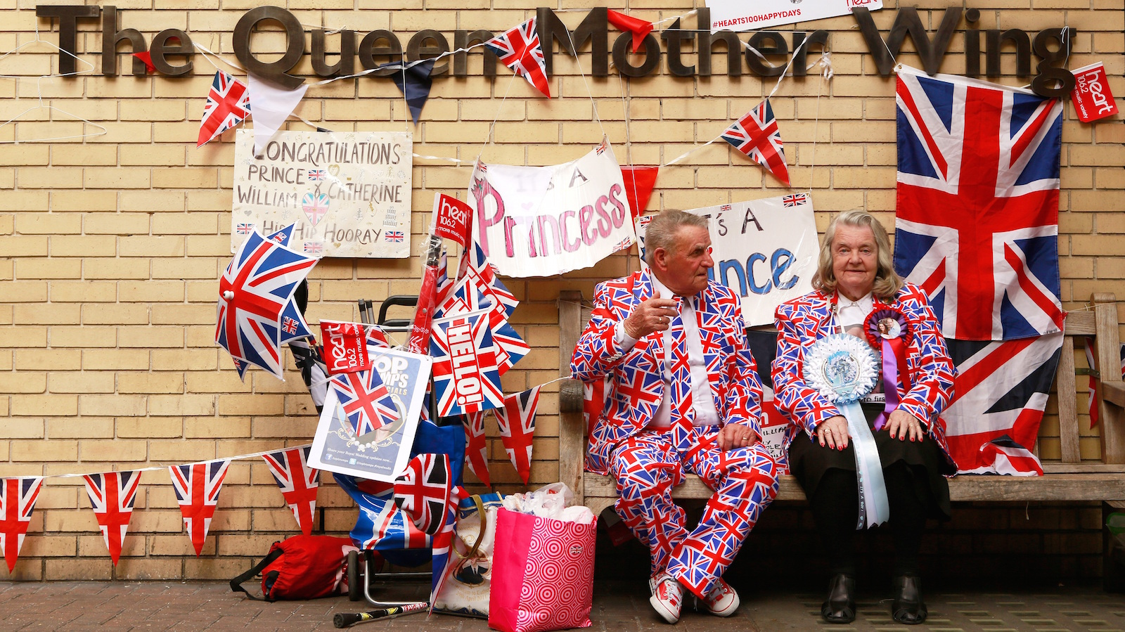 Royal enthusiasts sit outside the Lindo wing of St Mary's Hospital where Britain's Catherine, Duchess of Cambridge, is expected to give birth to her second child in the next few days, in central London, England, April 27, 2015.  REUTERS/Cathal McNaughton  TPX IMAGES OF THE DAY - RTX1AGKV