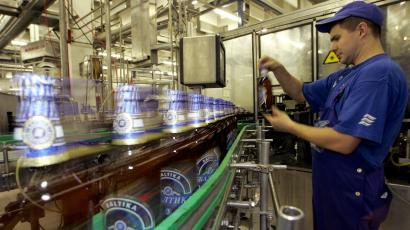 A brewery worker checks a bottle in the Baltika brewery in St. Petersburg, Russia.