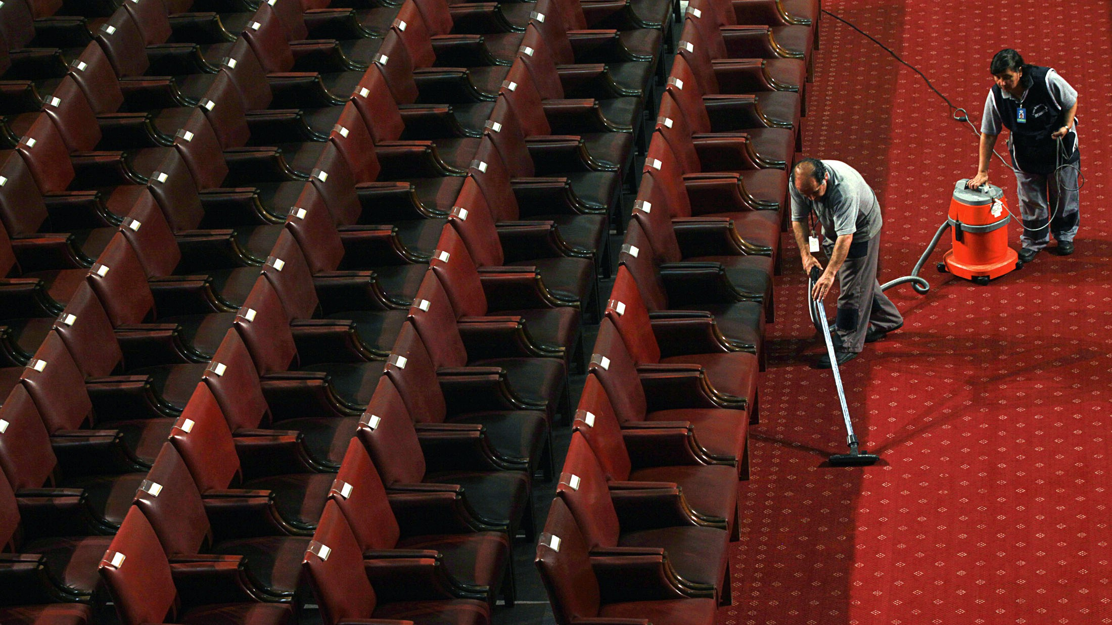 Workers clean the carpet in the Chilean Congress before the inauguration ceremony for President-elect Sebastian Pinera, in Valparaiso March 11, 2010. Conservative billionaire Pinera takes office as Chile's new president on Thursday, tasked with rebuilding the country after one of the worst earthquakes ever recorded killed hundreds of people less than two weeks ago.