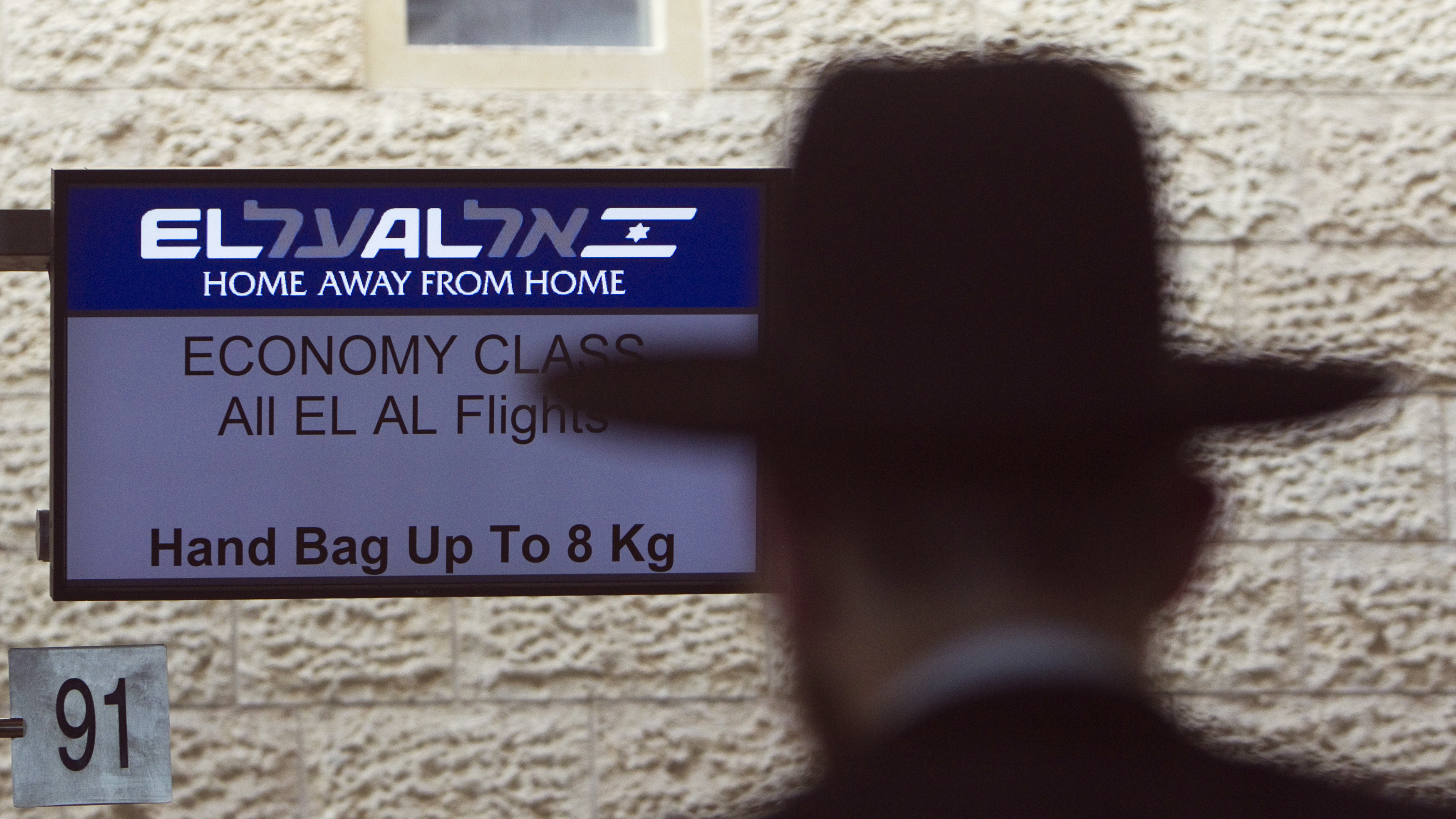 An El Al Israel Airlines logo is seen on an electronic board at a check-in counter at Ben Gurion International airport near Tel Aviv