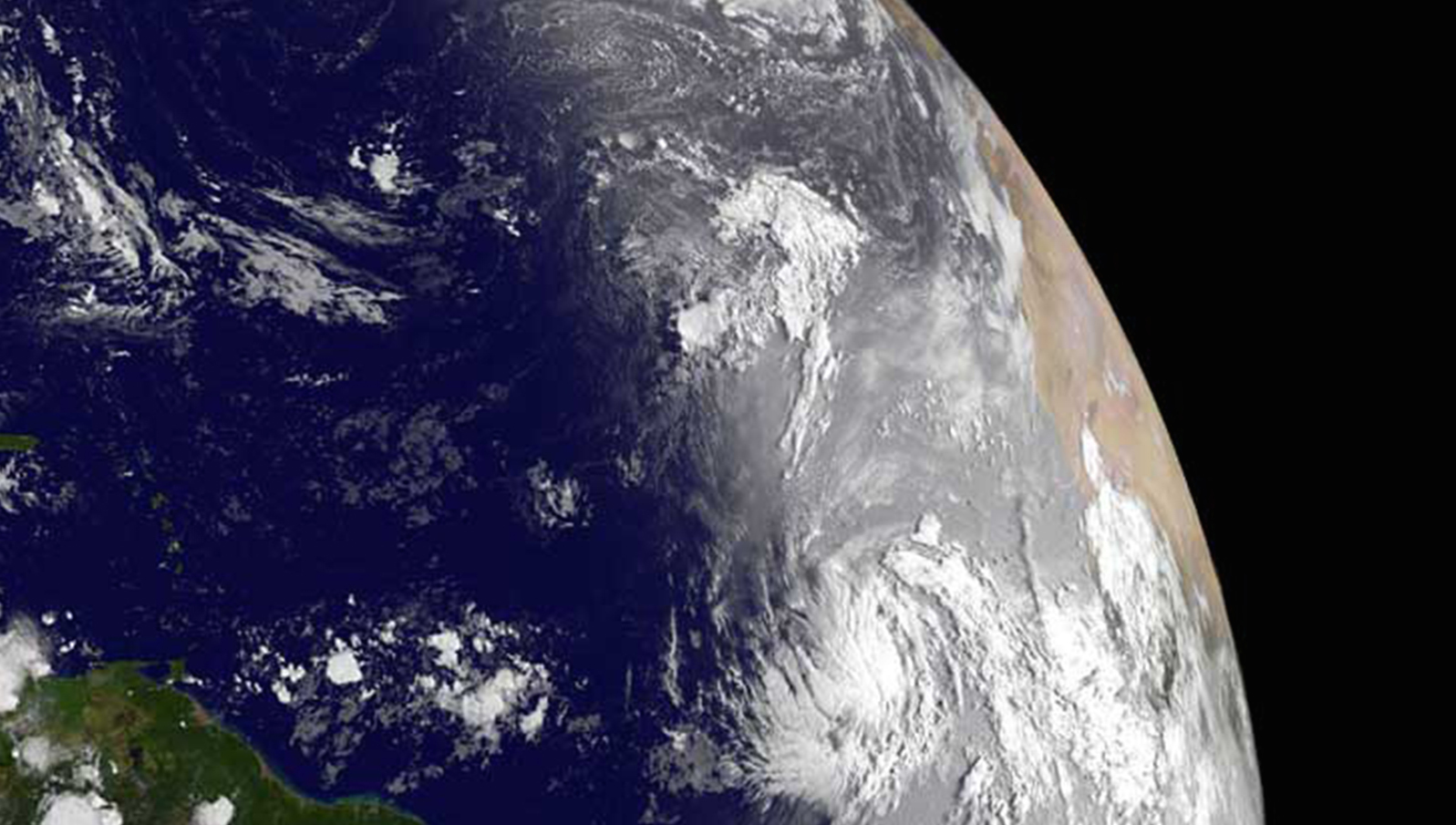 NASA handout image taken by the GOES-13 satellite shows Tropical Storm Katia (center, right) over the Atlantic Ocean August 30, 2011. Katia has top winds of 60 miles per hour (95 km per hour) and is jogging west at a brisk 22 mph (35 kph), the U.S. National Hurricane Center said, and it could become a hurricane on Wednesday. But beyond predicting Katia will be a major hurricane northeast of the Caribbean's northern Leeward Islands by Sunday, the Miami-based center says it is not possible now to predict its path with certainty, or say whether it will threaten the U.S. East Coast.