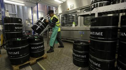 An employee moves beer barrels at the Meantime brewery in east London.