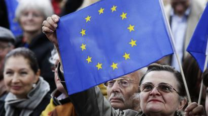 A woman holds up a EU flag during the speech of German Chancellor Angela Merkel at an election rally in Berlin.
