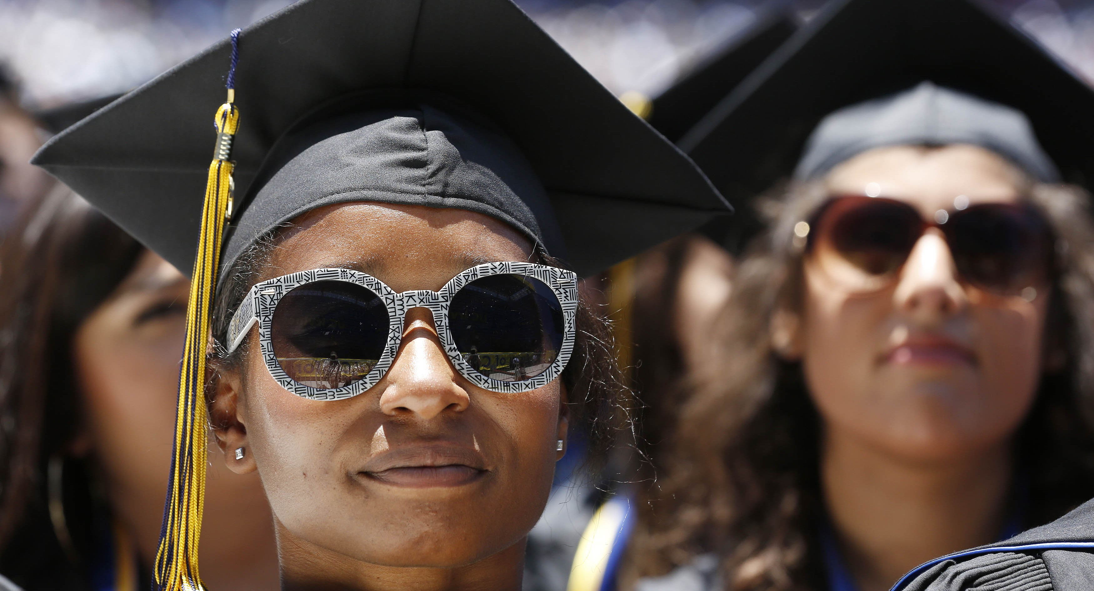 Students listen as U.S. President Barack Obama talks during the commencement ceremony for the University of California, Irvine at Angels Stadium in Anaheim, California June 14, 2014. REUTERS/Larry Downing