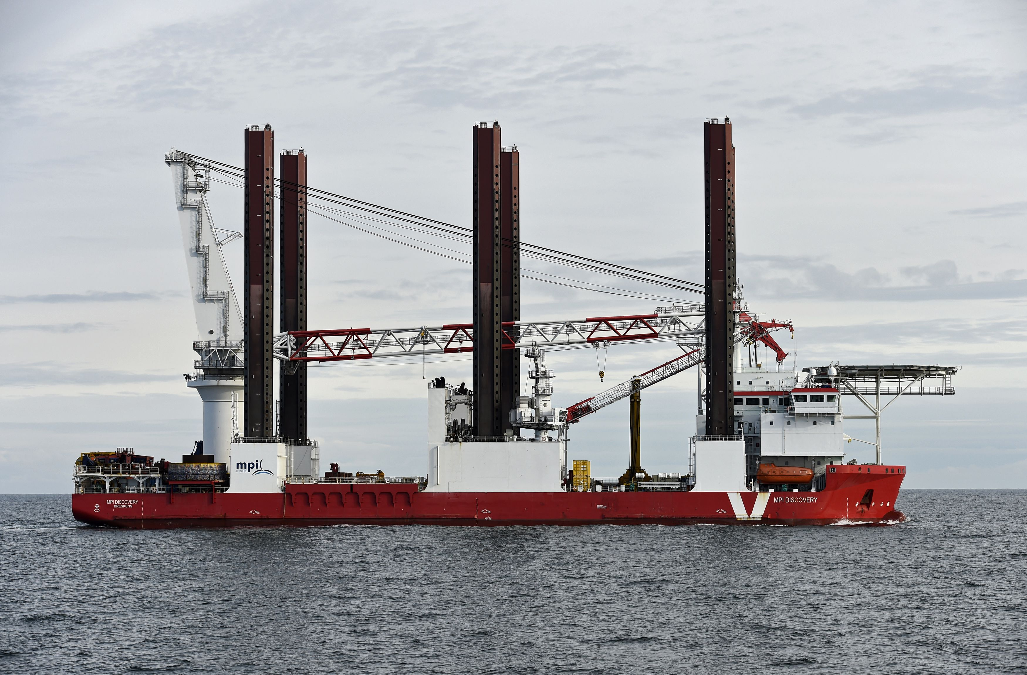 "An installation vessel with cranes, used by German energy company E.O.N., at the ""Amrumbank West"" wind farm."