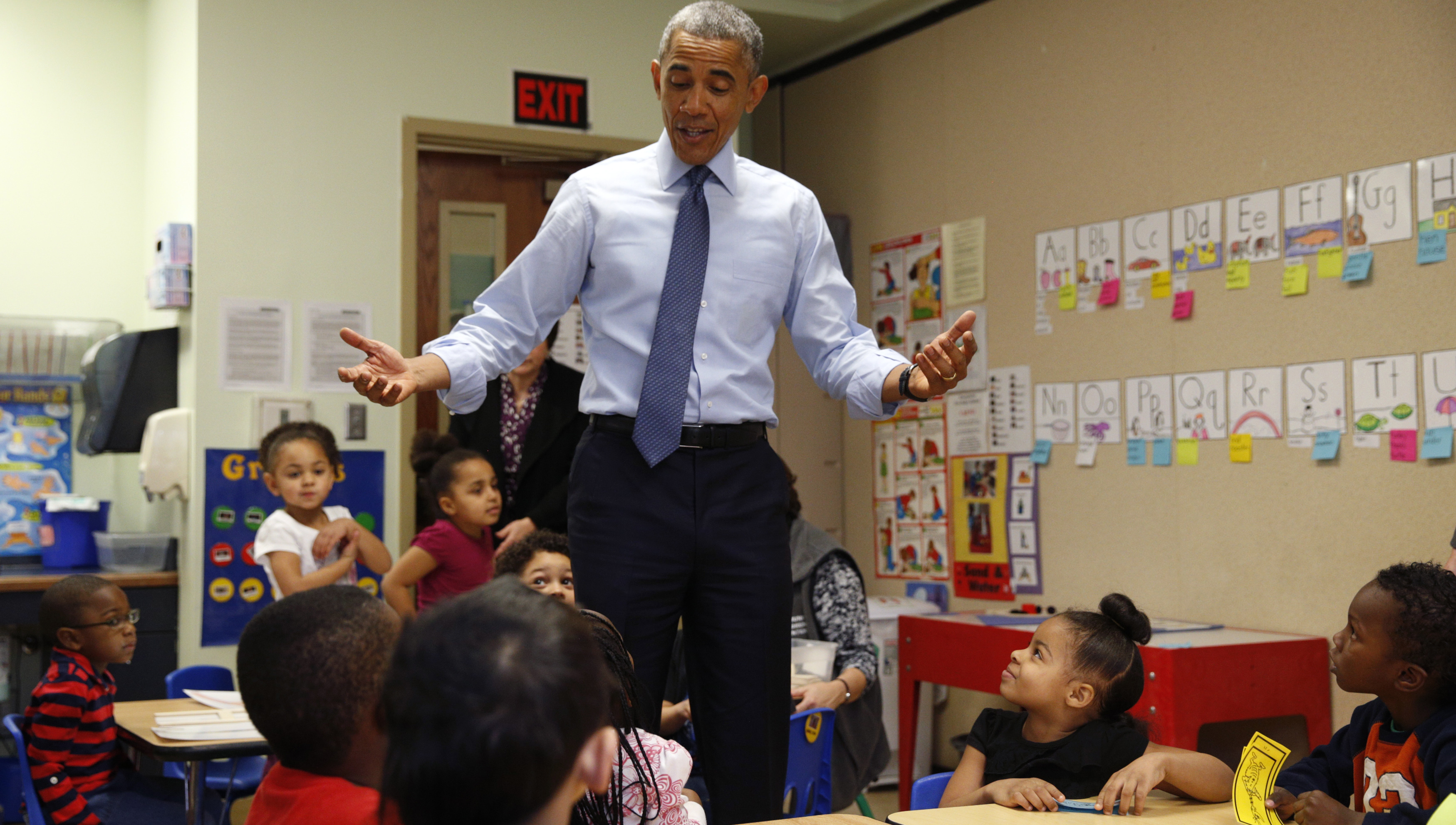 U.S. President Barack Obama visits a classroom at the Community Children's Center in Lawrence