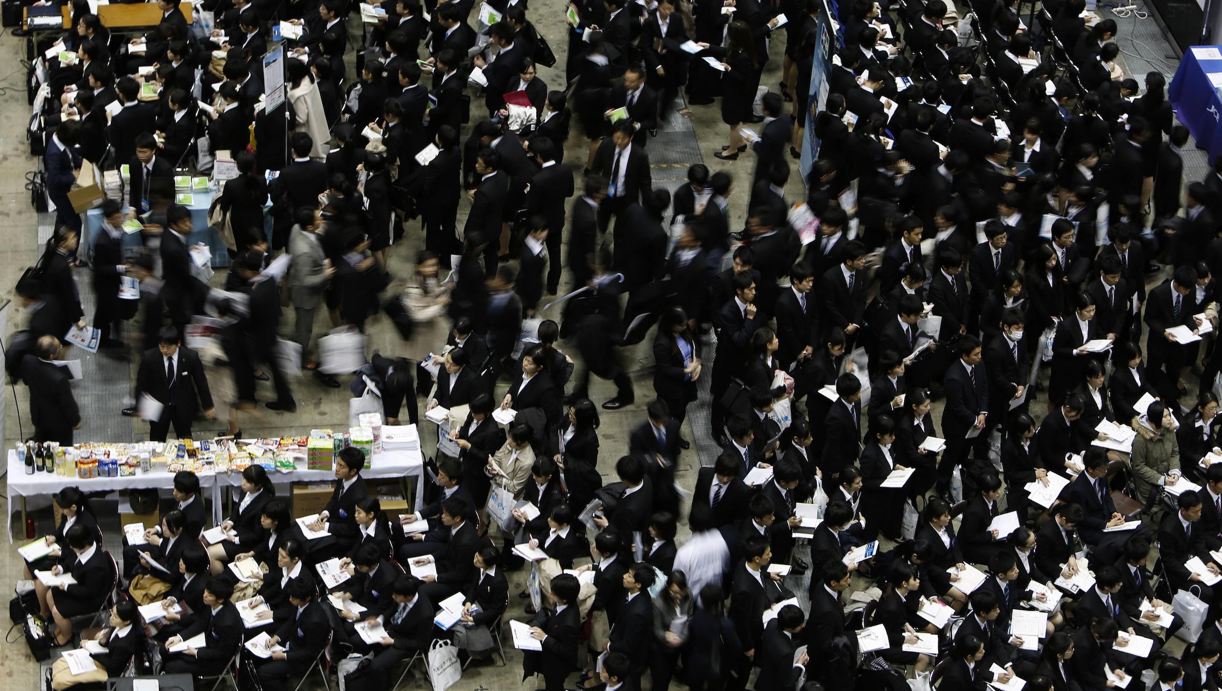 Job seekers attend a job fair held for fresh graduates in Tokyo