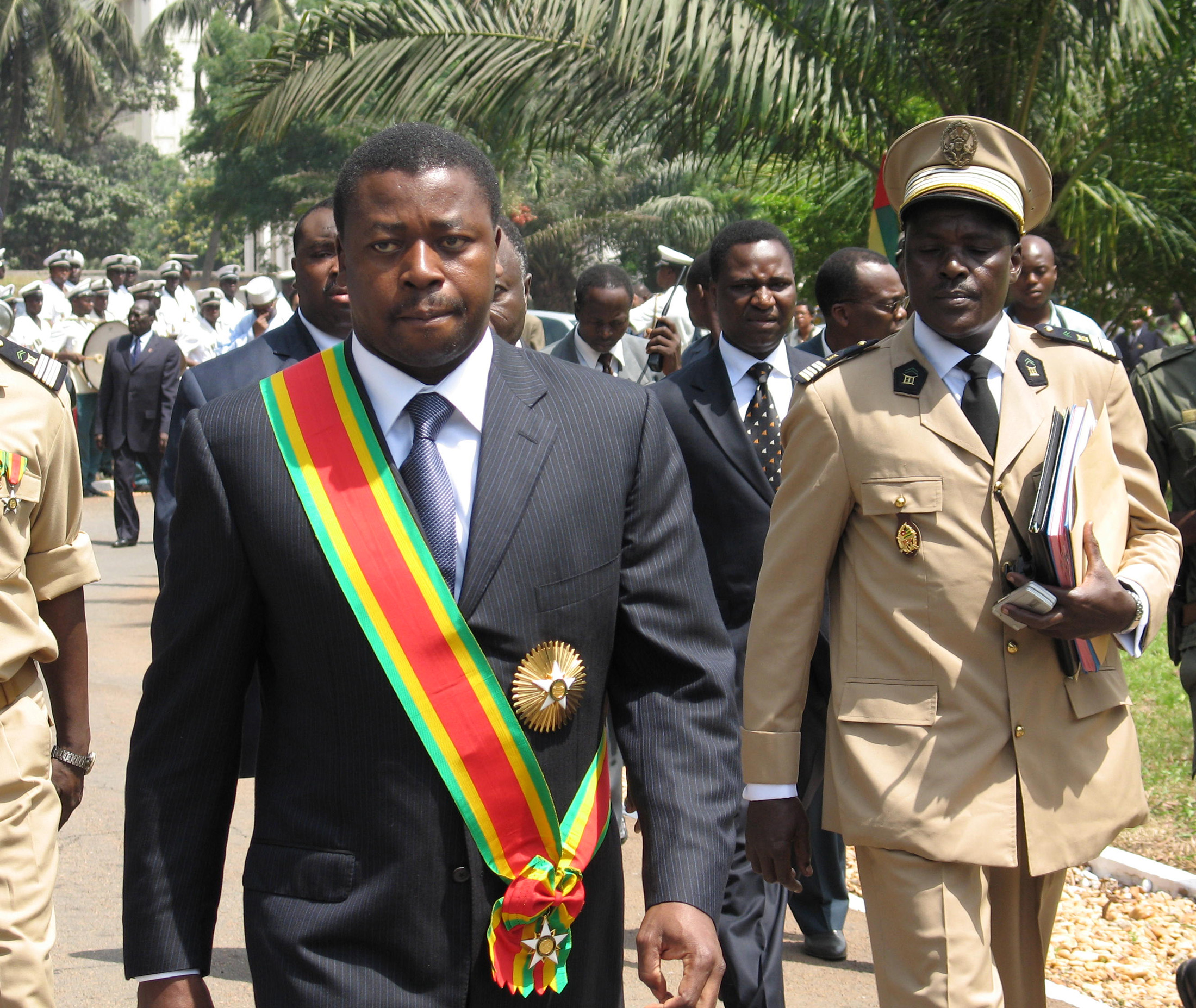 Faure Gnassingbe (L), the son of Togo's deceased president, was formally sworn in as President, in Lome, February 7, 2005, despite growing condemnation from African leaders who have denounced the swift succession as unconstitutional and called for elections. Gnassingbe took his oath of office in front of judges and lawmakers.  REUTERS/Noel Kokou Tadegnon - RTRMLZP