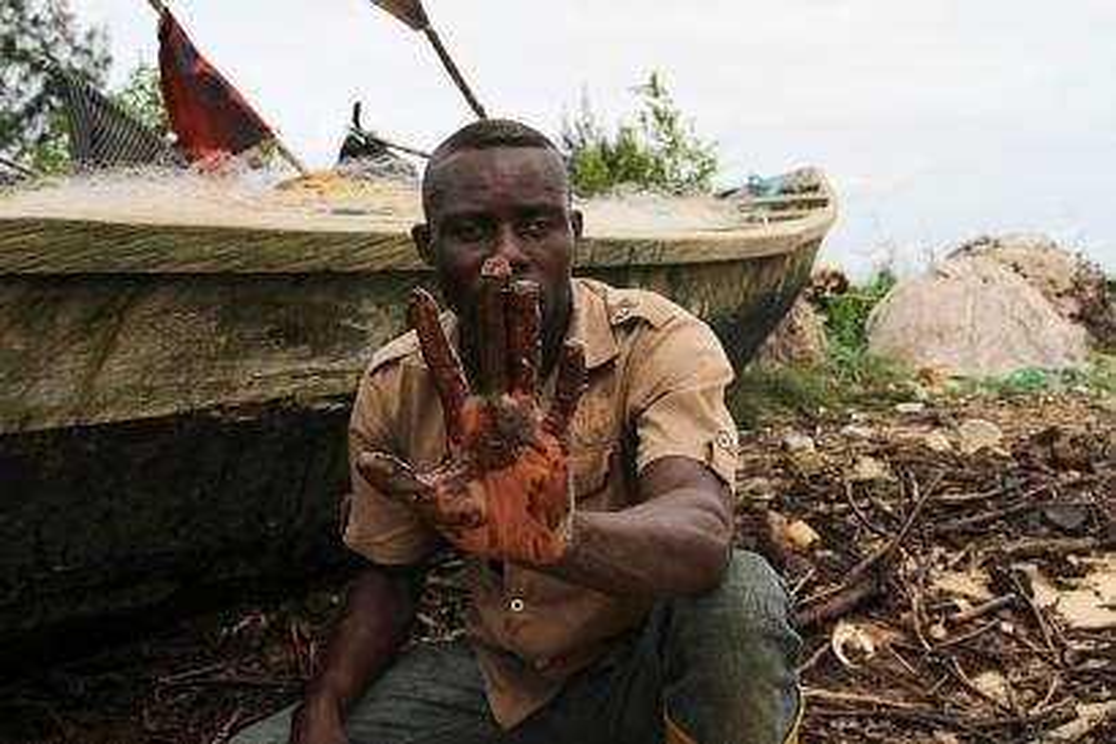 A fisherman shows oil slick
