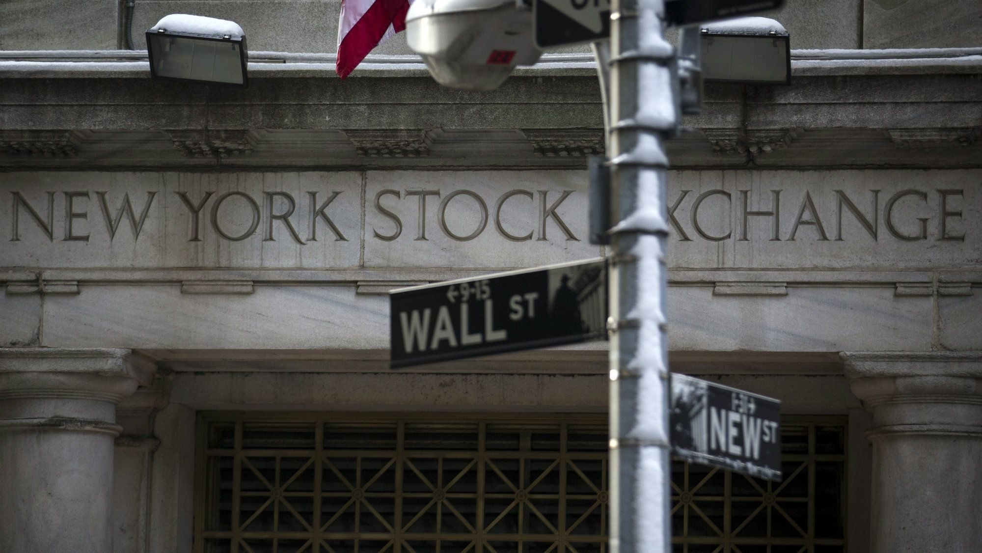 The Wall St. sign is seen outside the door to the New York Stock Exchange in New York's financial district.