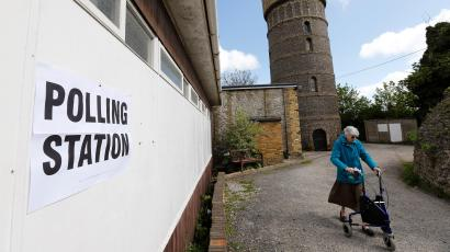 A woman arrives at a polling station in Broadstairs, southeast Britain
