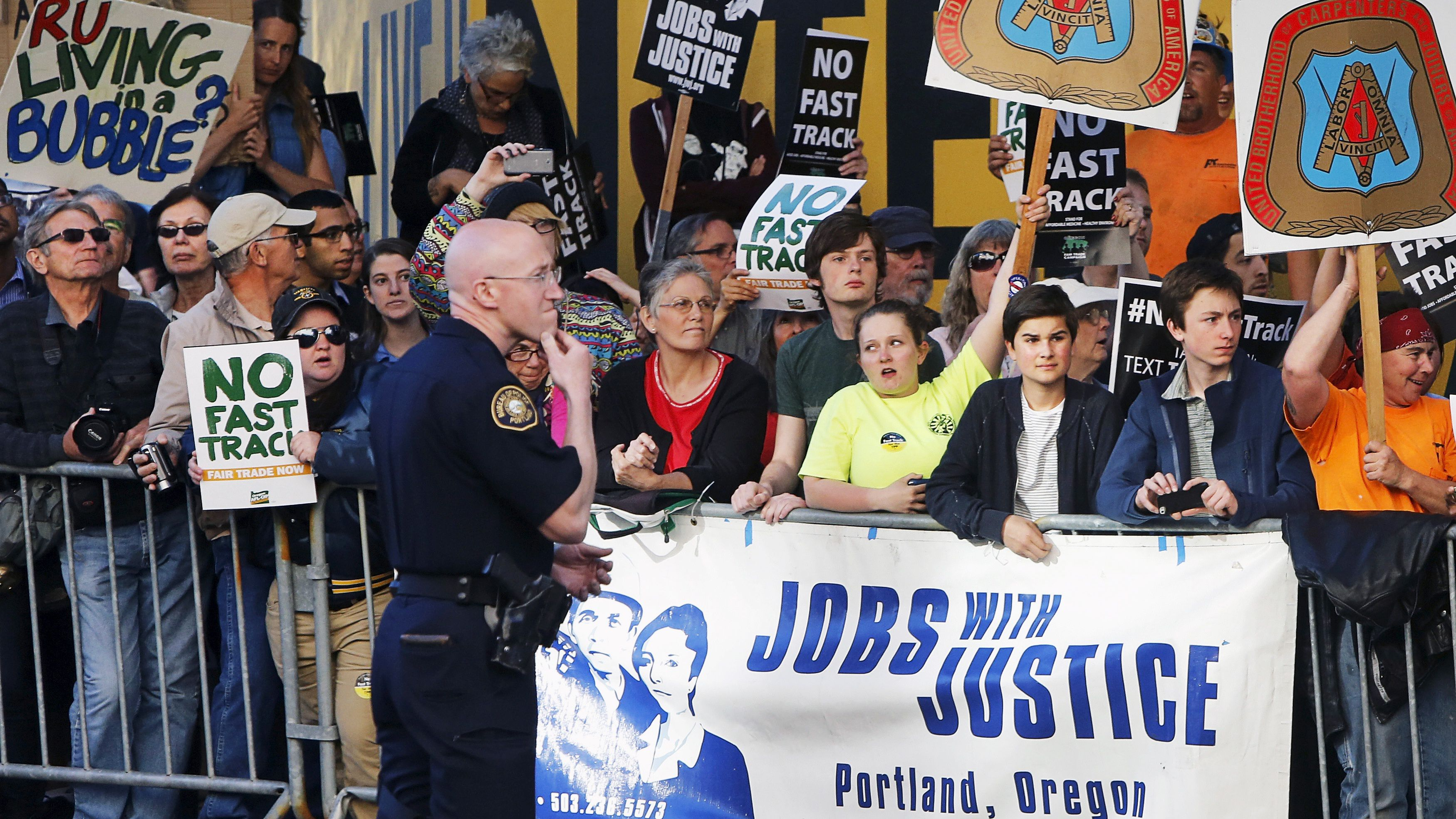 Protesters, many against the so-called fast track trade authority of the Trans-Pacific Partnership (TPP) trade agreement, rally outside the hotel where U.S. President Barack Obama is participating in a Democratic National Committee (DNC) event in Portland, Oregon May 7, 2015.