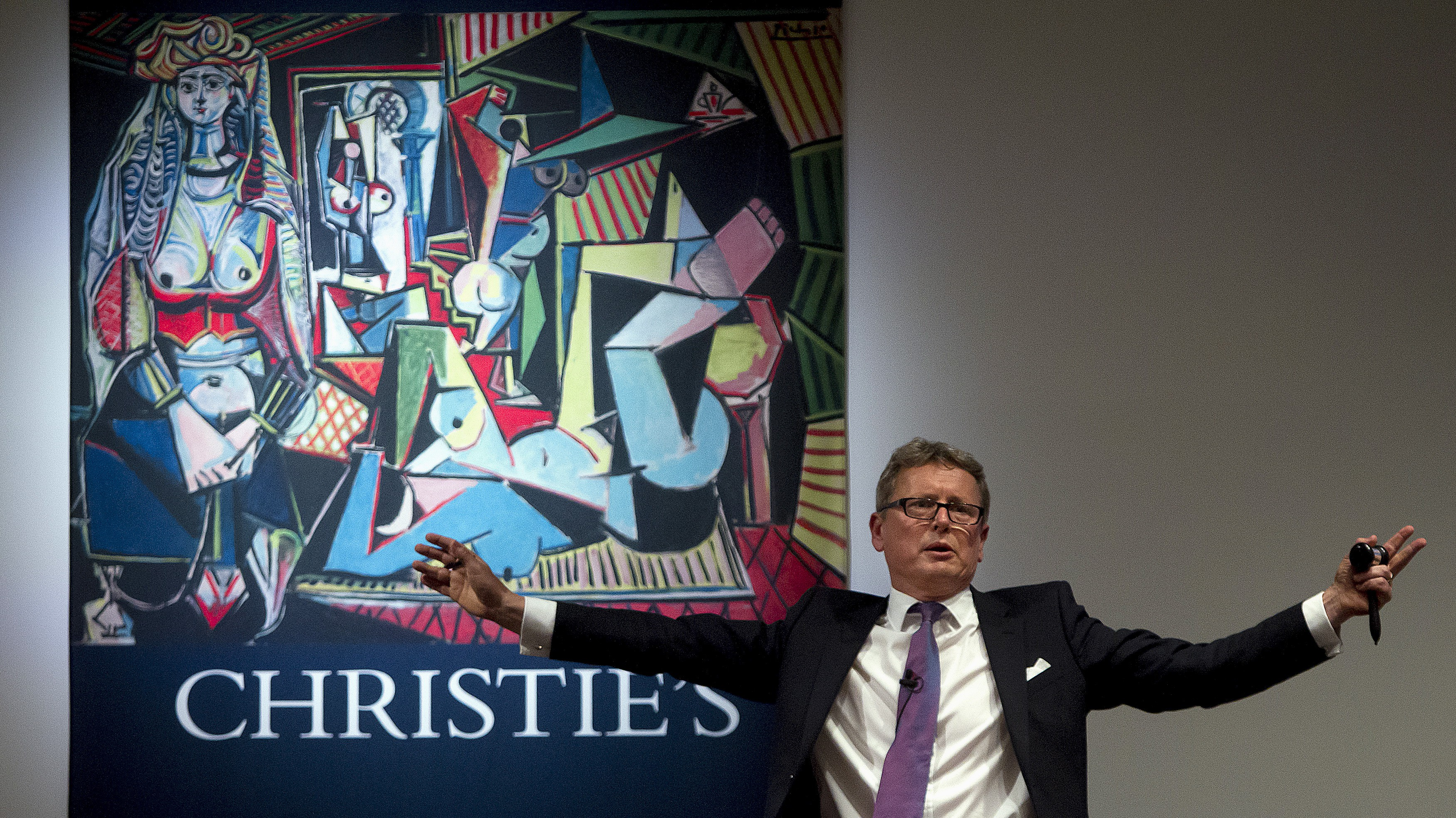 "Auctioneer Jussi Pylkkanen calls for final bids before dropping the gavel as he sells Pablo Picasso's ""Les femmes d'Alger (Version 'O')"" (Women of Algiers) at Christie's Auction House in the Manhattan borough of New York May 11, 2015. The auction house had estimated the 1955 cubist oil ""Les femmes d'Alger (Version ""O"")"" would sell for about $140 million, but several bidders competing via telephone drove the winning bid to $160 million, for a final price of $179,365,000 including Christie's commission of just over 12 percent. REUTERS/Carlo Allegri      TPX IMAGES OF THE DAY      - RTX1CIKY"