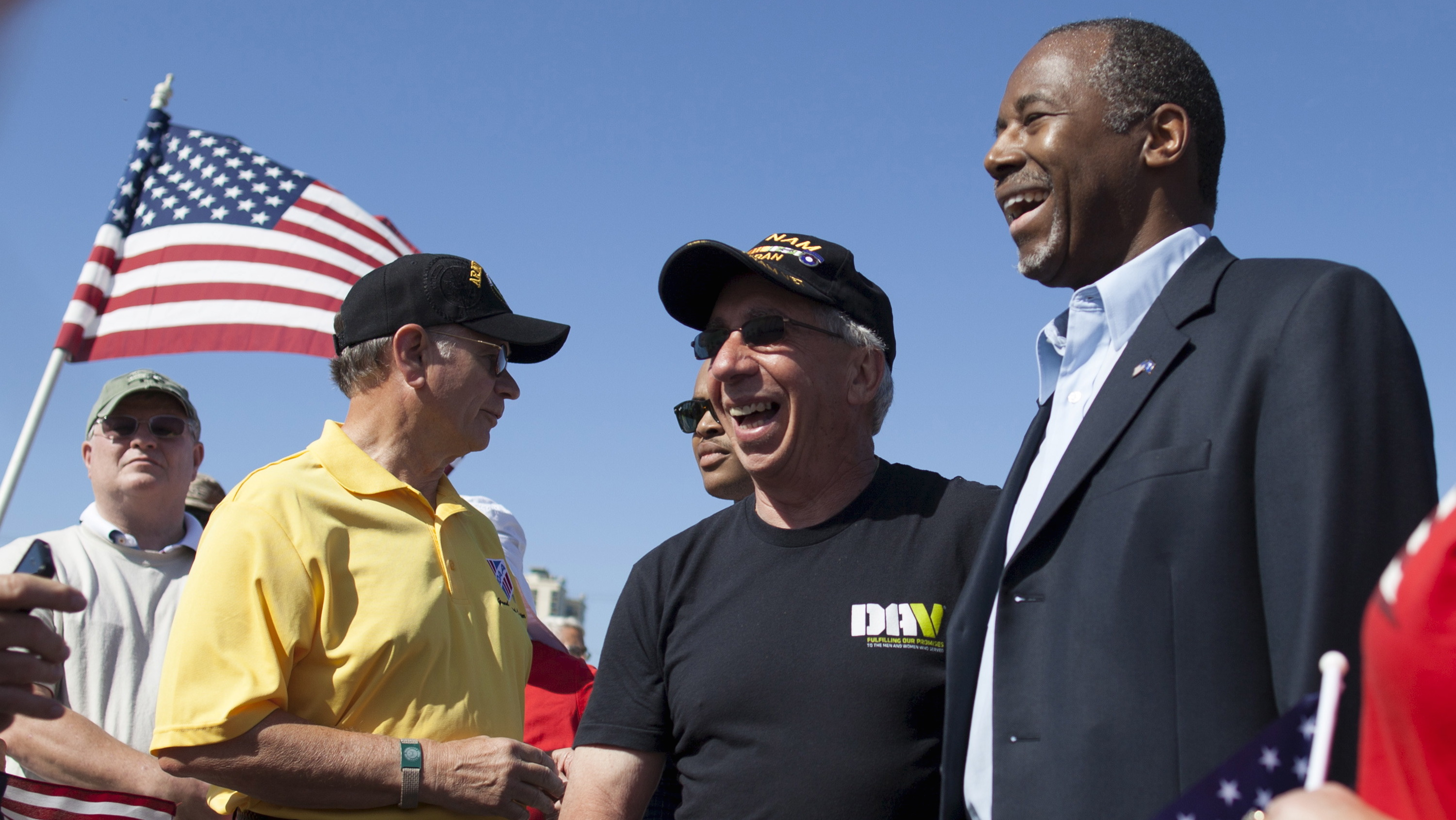 Republican presidential candidate Ben Carson poses for photos with veterans after a march by veterans to mark Memorial Day, as part of a election campaign stop in Myrtle Beach