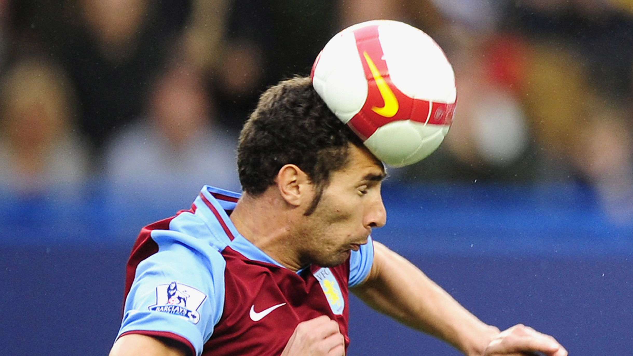 Aston Villa's Carlos Cuellar heads the ball against Chelsea during their English Premier League soccer match at Stamford Bridge in London October 5, 2008.