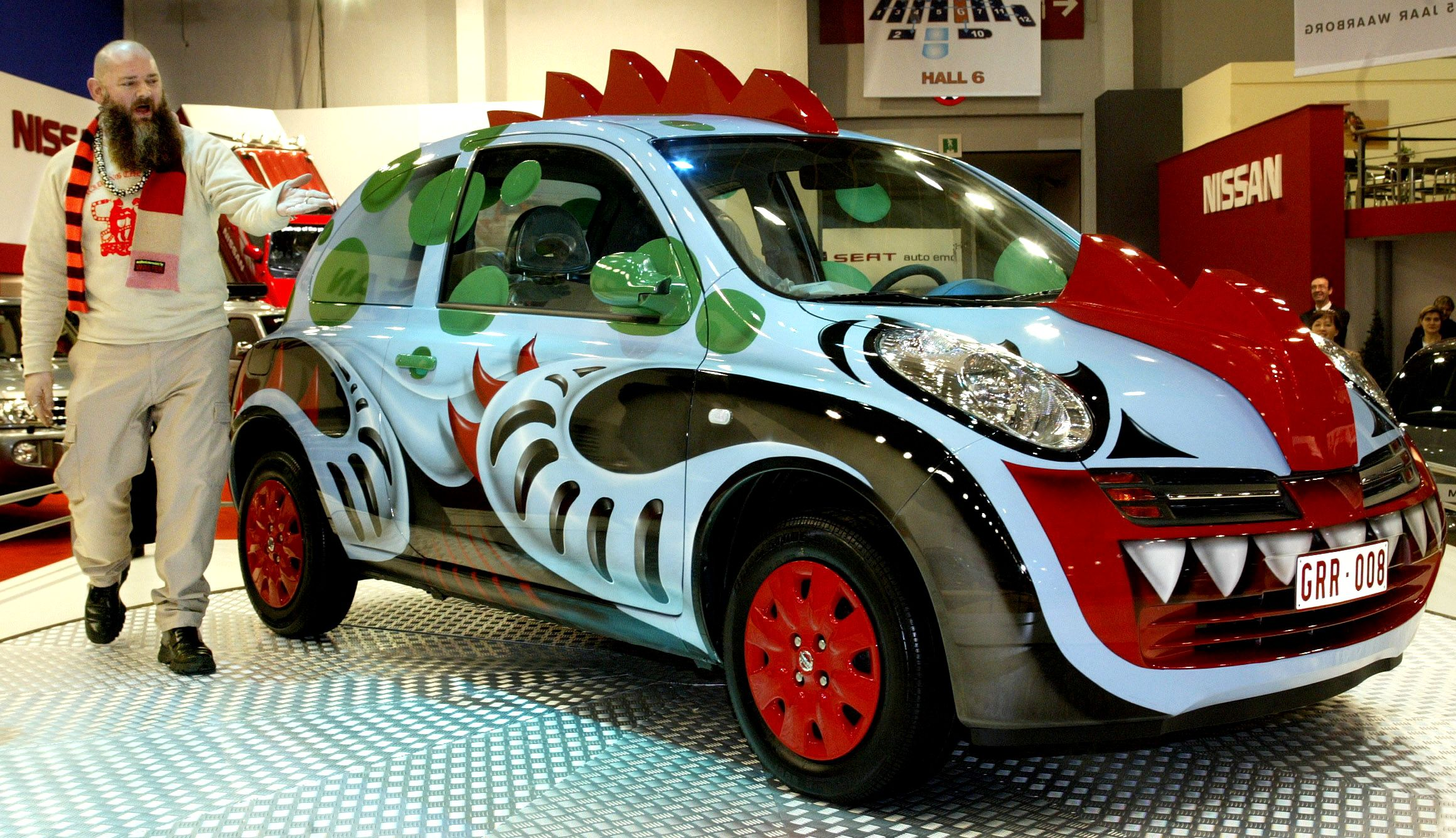 Belgian fashion designer Walter Van Beirendonck launches a customised Nissan Micra at the Brussels International Auto Show on January 13, 2004. The benefits of Van Beirendonck's car sale will be donated to a hospital in the research to fight Aids. The car show, which runs from January 15 to January 25, is expected to attract about 750,000 visitors.