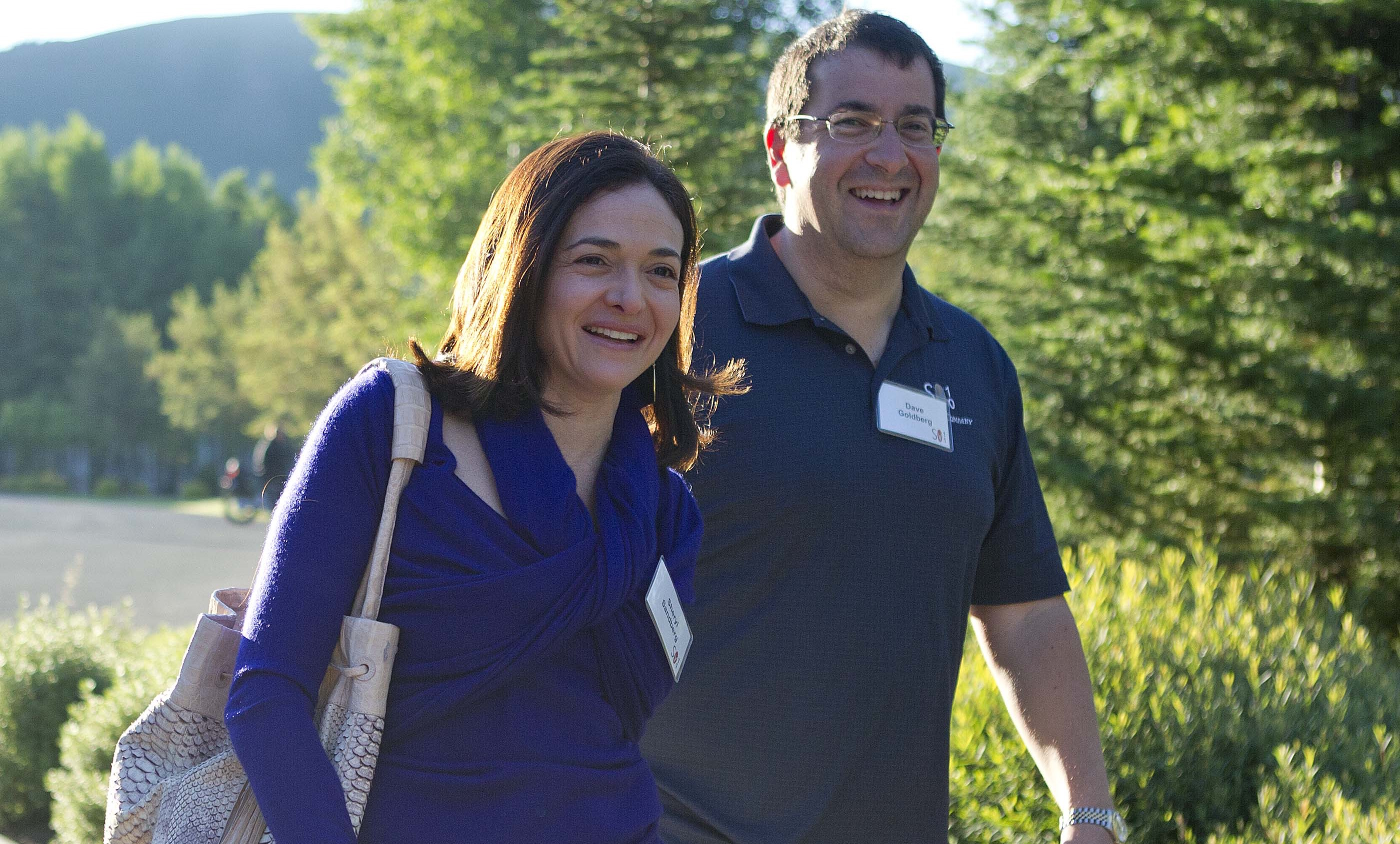 Facebook chief operating officer Sheryl Sandberg, left, and Dave Goldberg, CEO of Survey Monkey, arrive at the Sun Valley Inn for the 2011 Allen and Co. Sun Valley Conference, Wednesday, July 6, 2011, in Sun Valley, Idaho (AP Photo/Julie Jacobson)
